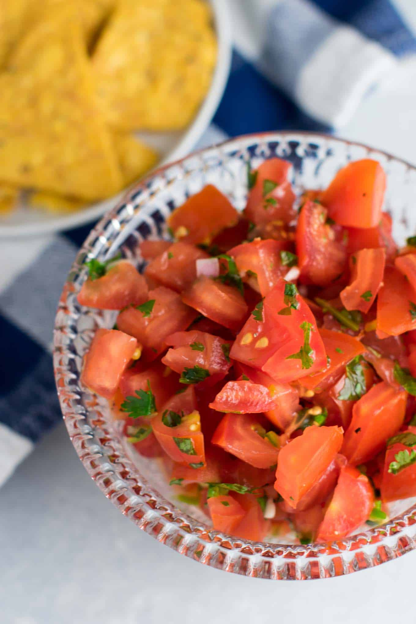 salsa in a bowl next to tortilla chips