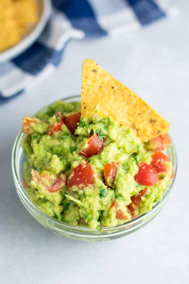 The best guacamole recipe with cherry tomatoes. #vegan #guacamole #bestguacamole #appetizers #gamedayfood
