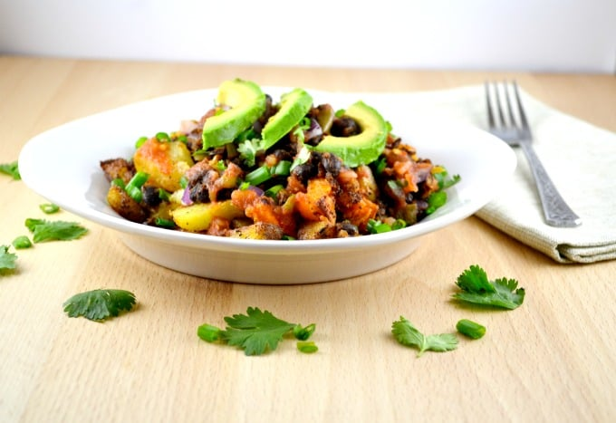vegan spicy potato taco bowl with fresh avocado and lime