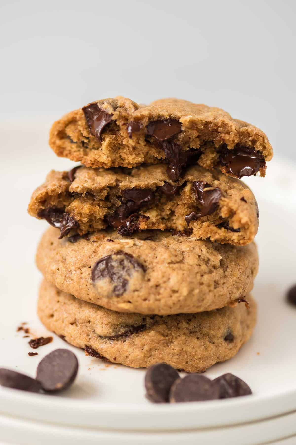 chocolate chip cookies broken in half and stacked to show the melted chocolate inside