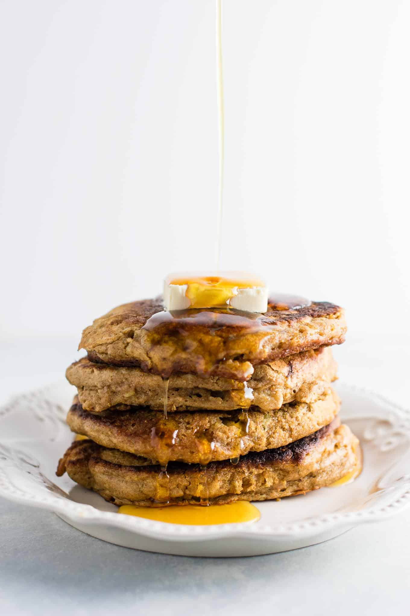 Healthy banana bread pancakes made with greek yogurt and whole wheat flour. These are amazing! #healthy #breakfast #bananabread #bananapancakes #pancakes #greekyogurt #wholewheat