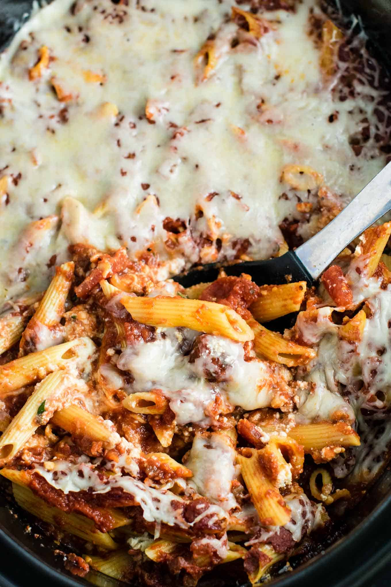 This Easy Crockpot Baked Ziti gets RAVE reviews. Everyone loves this when I make it! So simple to assemble and you don't even have to cook the noodles first! #crockpotbakedziti #ziti #pasta #slowcooker