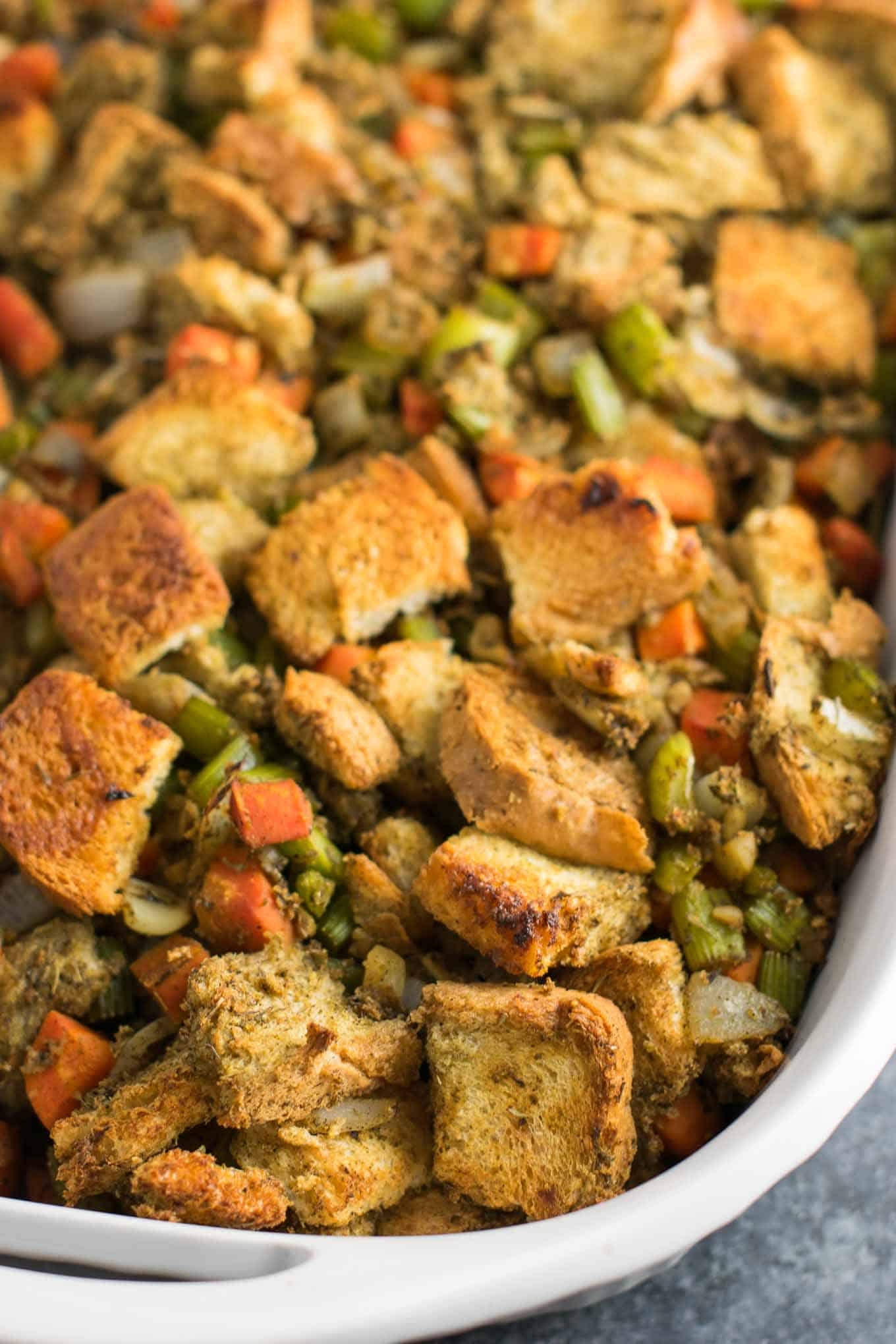 This easy vegan stuffing is simple to make and packed full of flavor. Easily made gluten free! This one will be a hit at your Thanksgiving table! #vegan #thanksgiving #stuffing #vegetarian