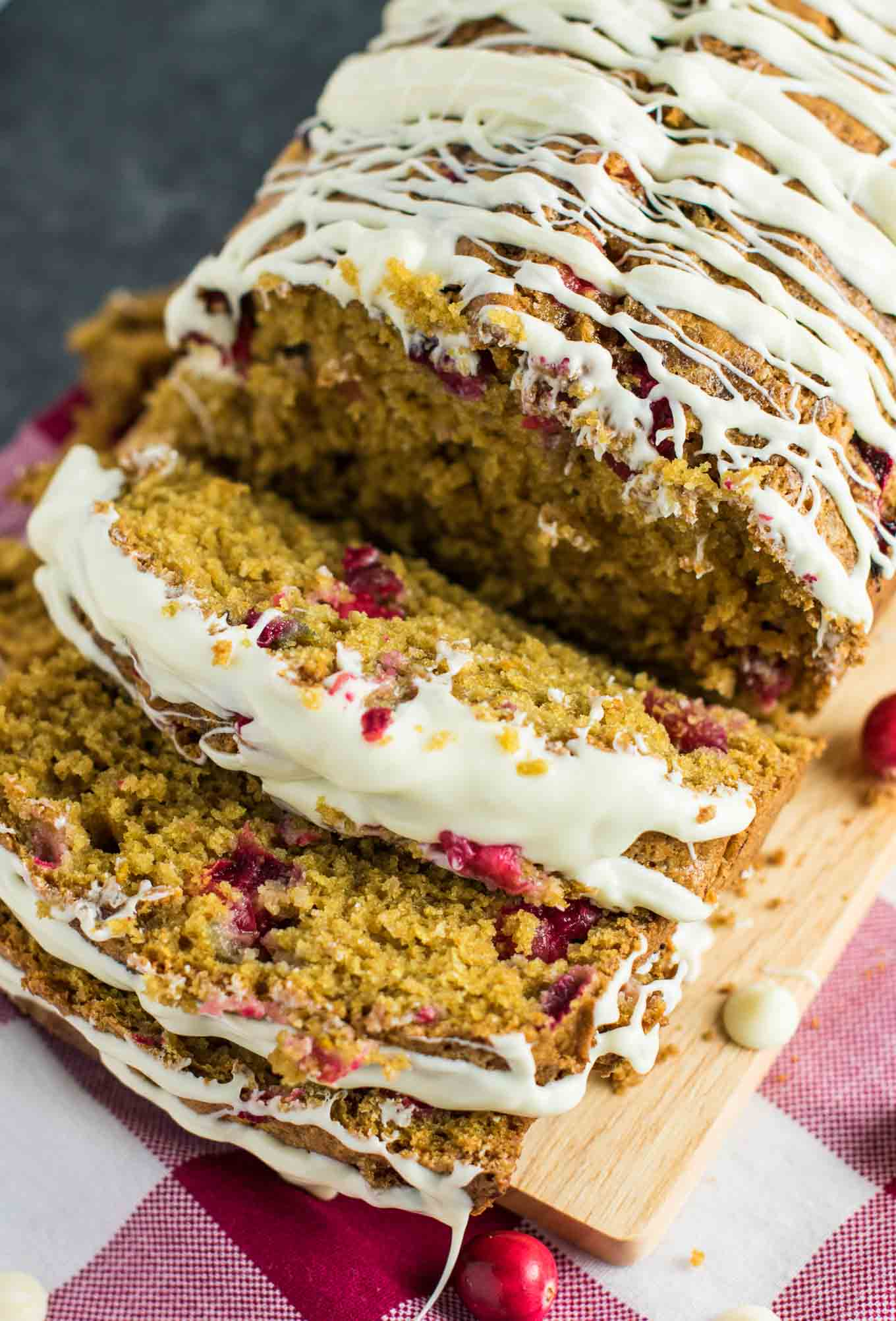 "White Chocolate Cranberry Eggnog Bread aka ""Crack Bread."" Everyone RAVES about this and can't get enough. Even eggnog haters will love this recipe! #christmasrecipes #eggnog #cranberry #cranberryeggnogbread"
