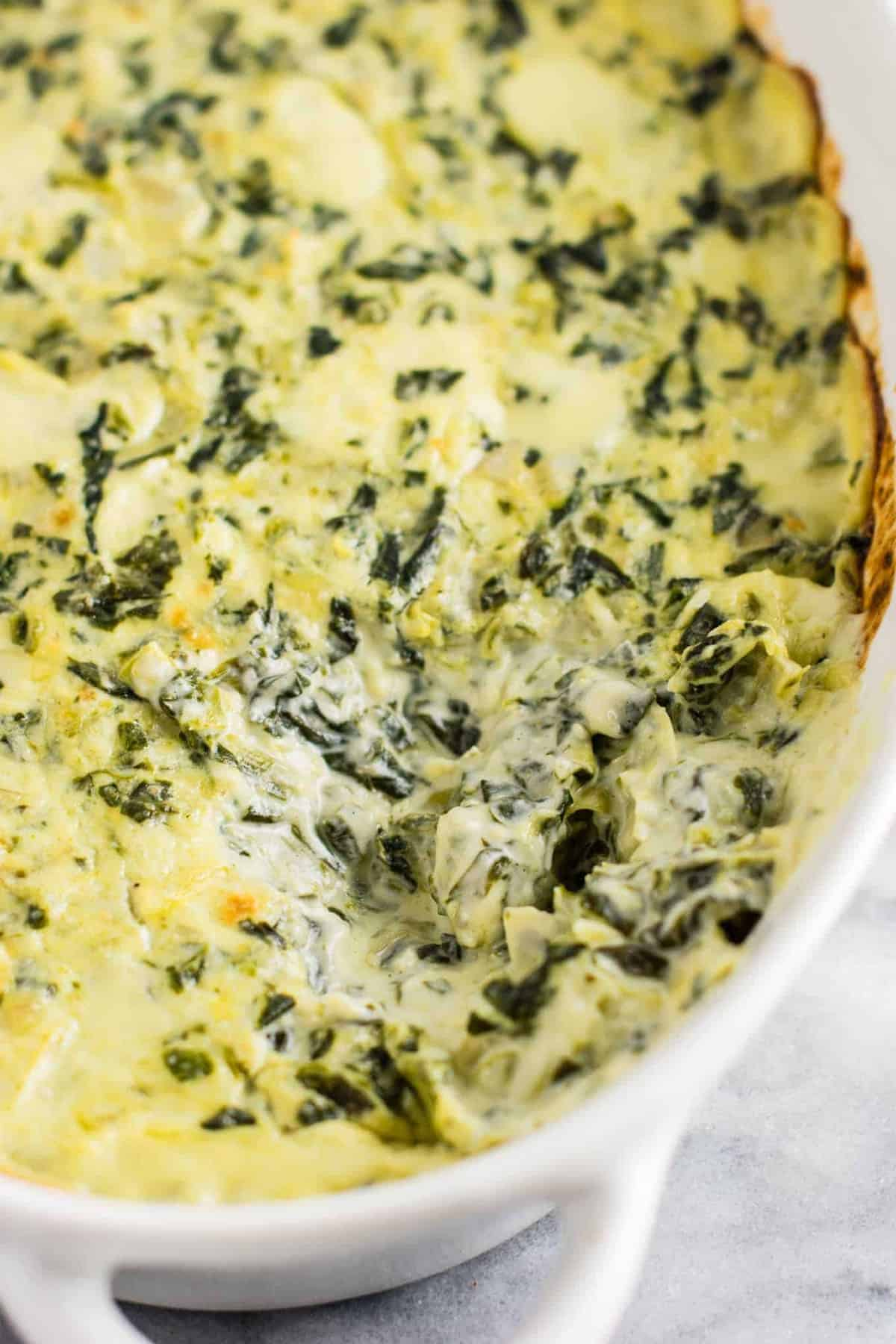 The best creamy spinach artichoke dip recipe with Havarti and parmesan cheese. This is a hit every time I make it! #spinachartichokedip #appetizer #spinachdip #vegetarian #havarti #parmesan #dips