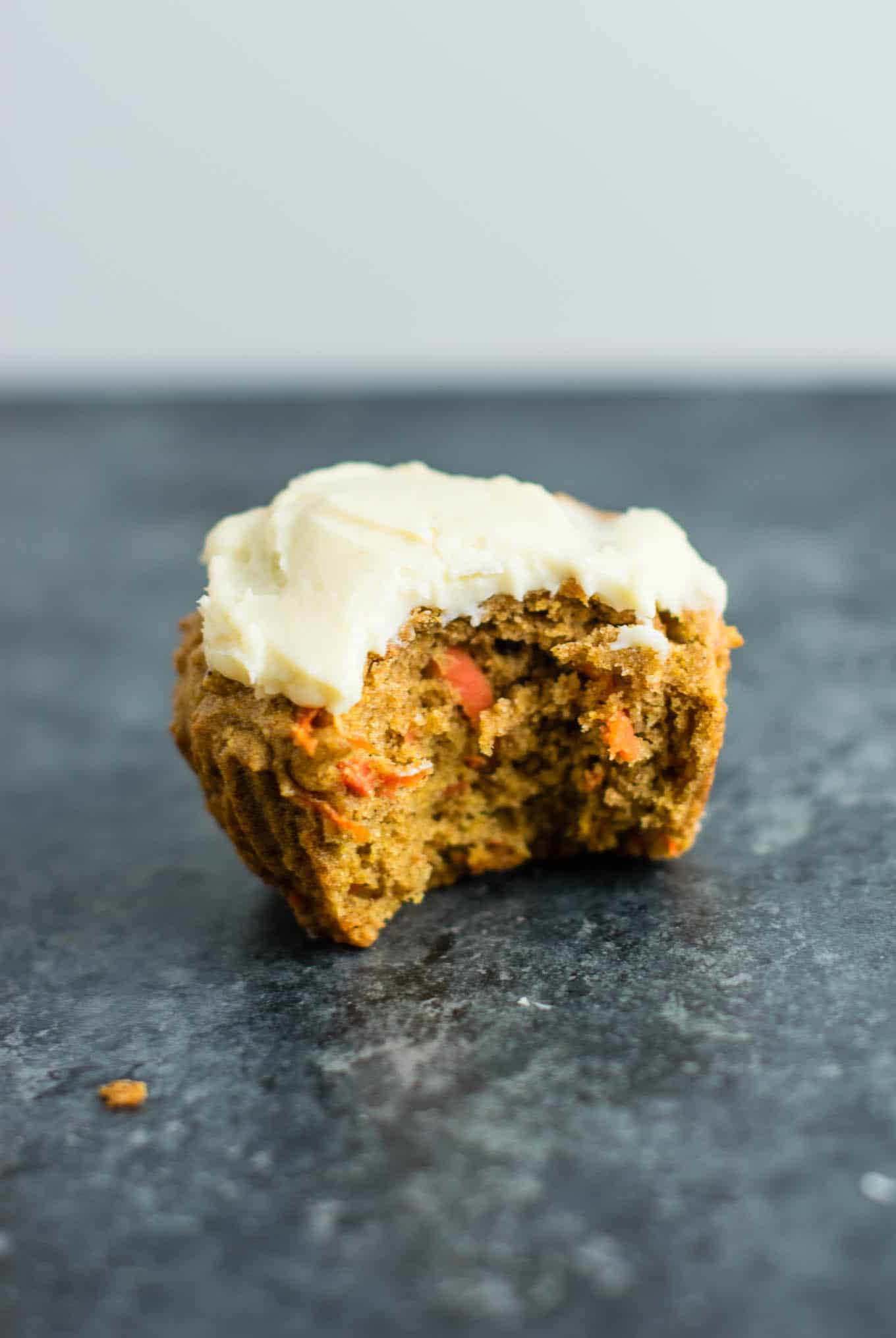 Whole wheat carrot cake muffins with cream cheese frosting - basically feel like I'm eating dessert for breakfast! #muffins #carrotcakemuffins #carrotcake #wholewheat #creamcheesefrosting #breakfast #vegetarian