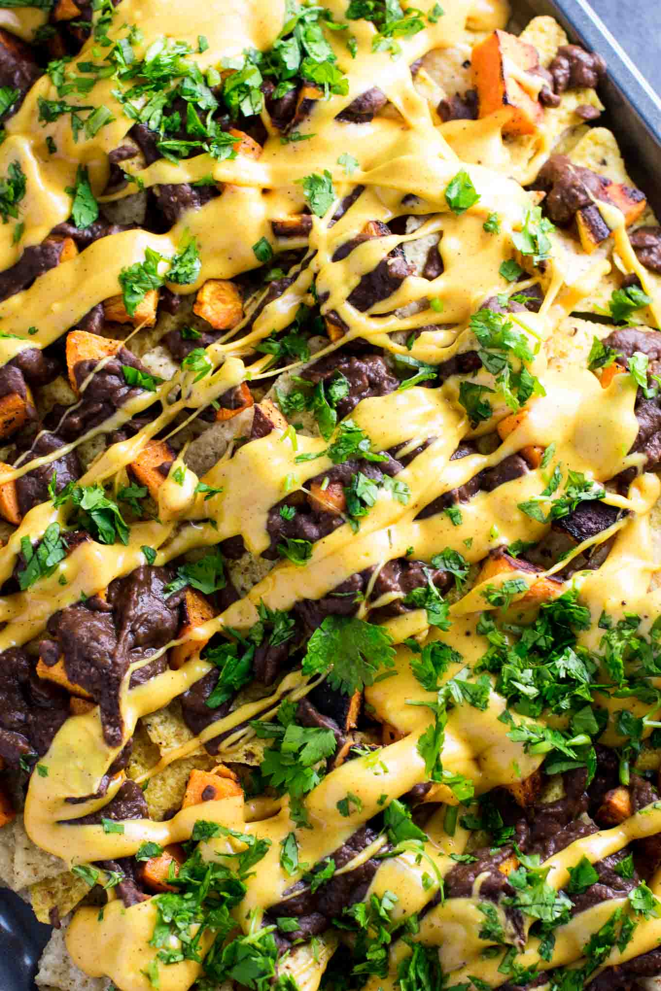 30 Minute Sweet Potato Refried Bean Nachos - recipe via @buildyourbite