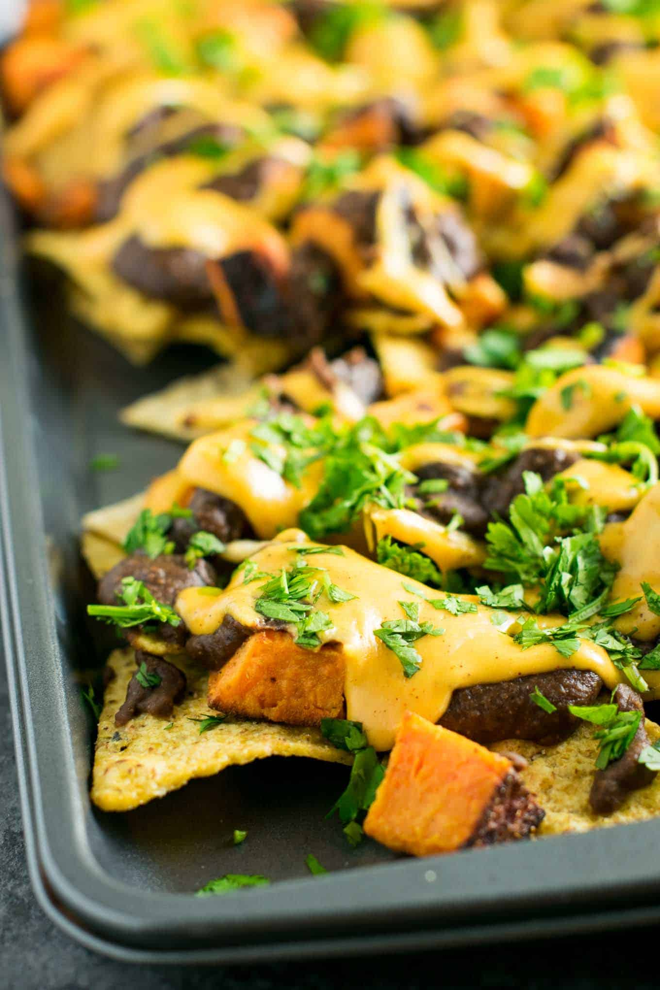 30 Minute Sweet Potato Refried Bean Nachos - recipe via @buildyourbite