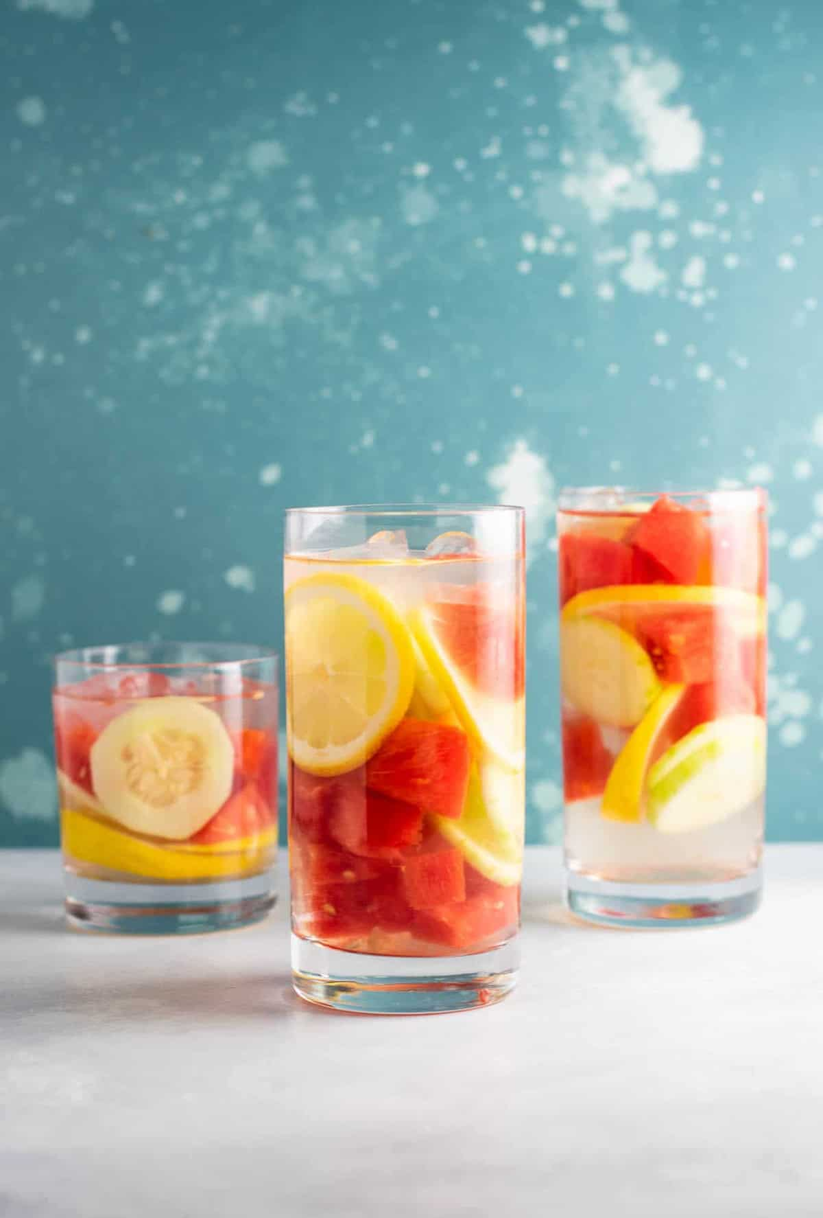 Watermelon detox water recipe with cucumbers and lemon #detoxwater #watermelon #watermelondetox #watermelonwater #vegan #drinks #healthy