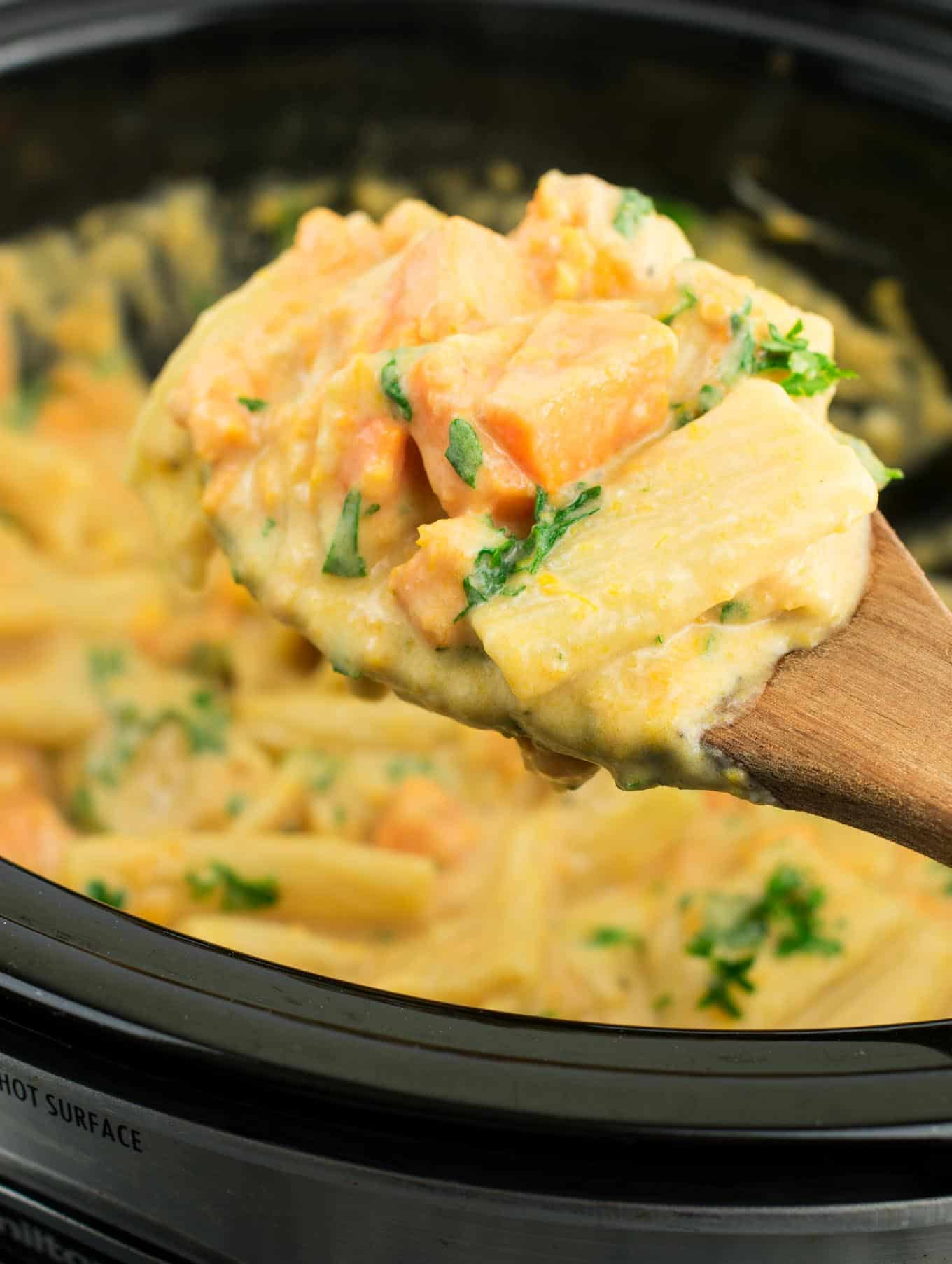 Easy crockpot alfredo pasta recipe with sweet potatoes. Just 8 ingredients and 10 minutes of prep to make this delicious slow cooker pasta!