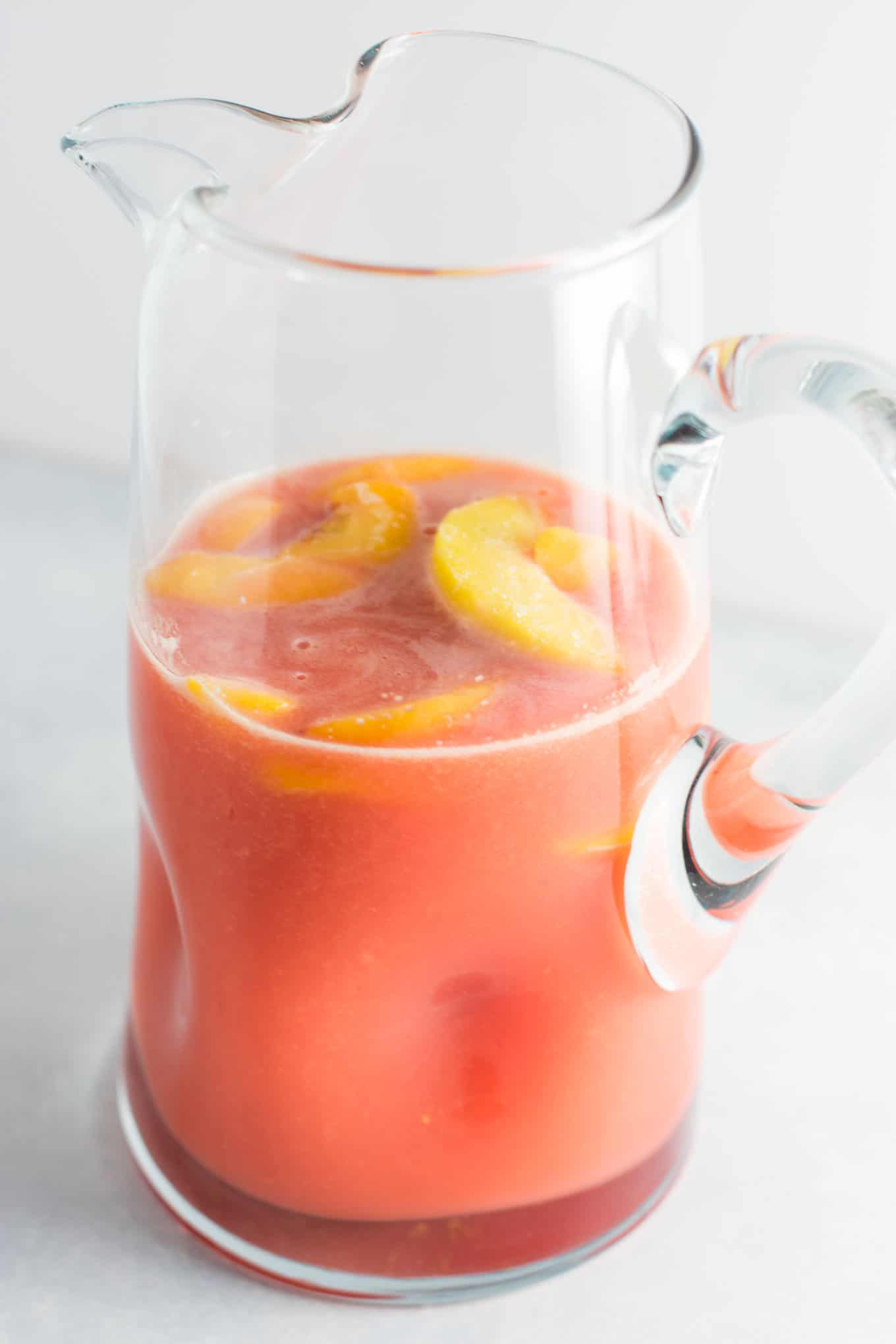 Fresh raspberry peach lemonade recipe made with lemons, raspberries, peaches, water, and maple syrup. Naturally sweetened and delicious!
