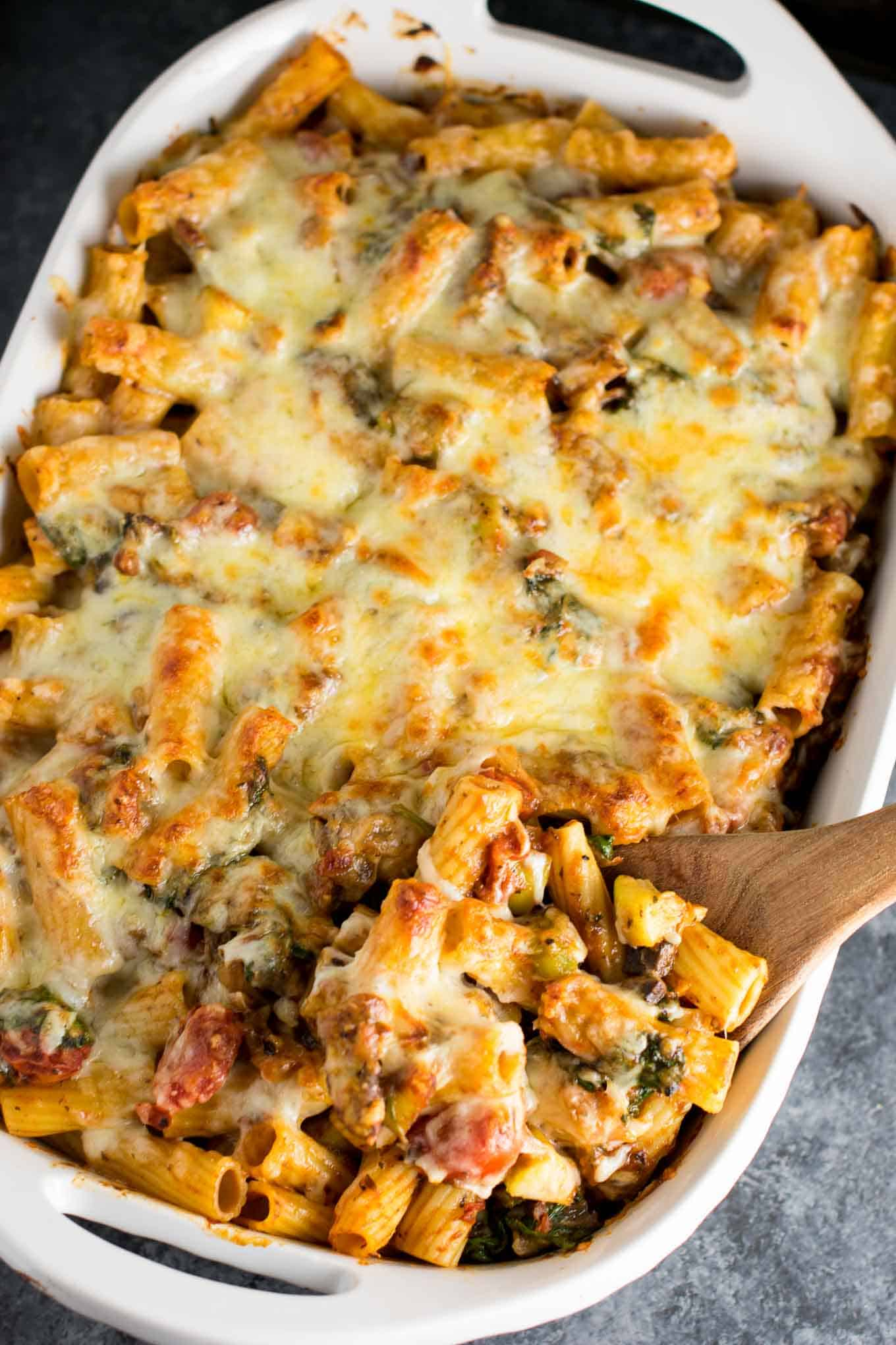 veggie lover's baked rigatoni recipe packed full of cherry tomatoes, onions, garlic, mushrooms, bell peppers, zucchini, and spinach. A hearty and delicious vegetarian dinner!