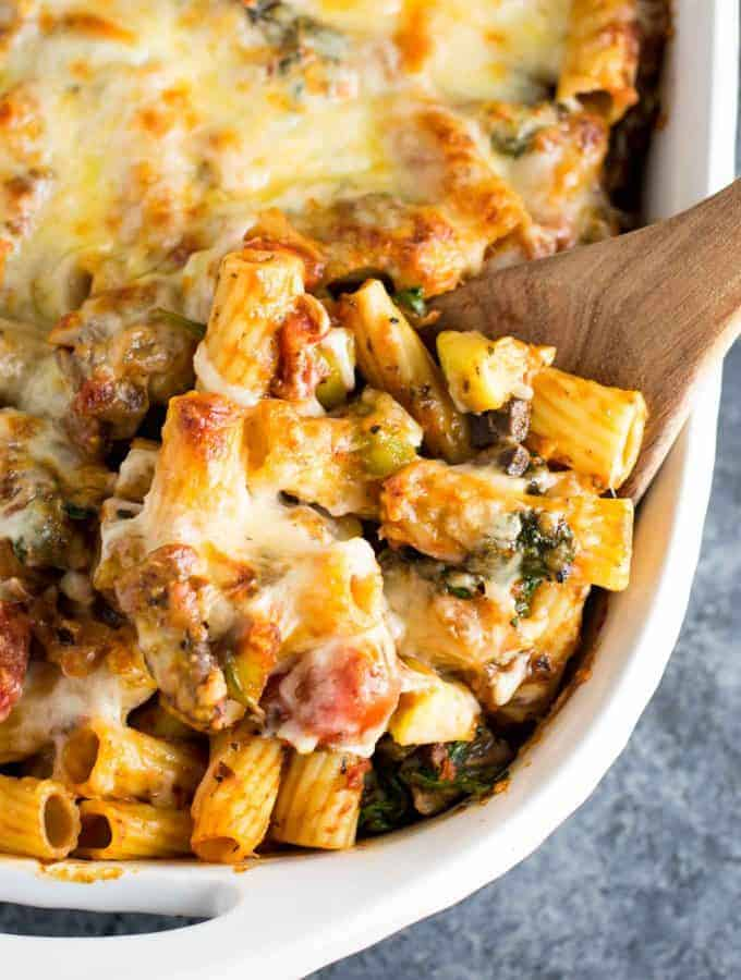 This veggie lover's baked rigatoni is packed full of cherry tomatoes, onions, garlic, mushrooms, bell peppers, zucchini, and spinach. A hearty and delicious vegetarian dinner!