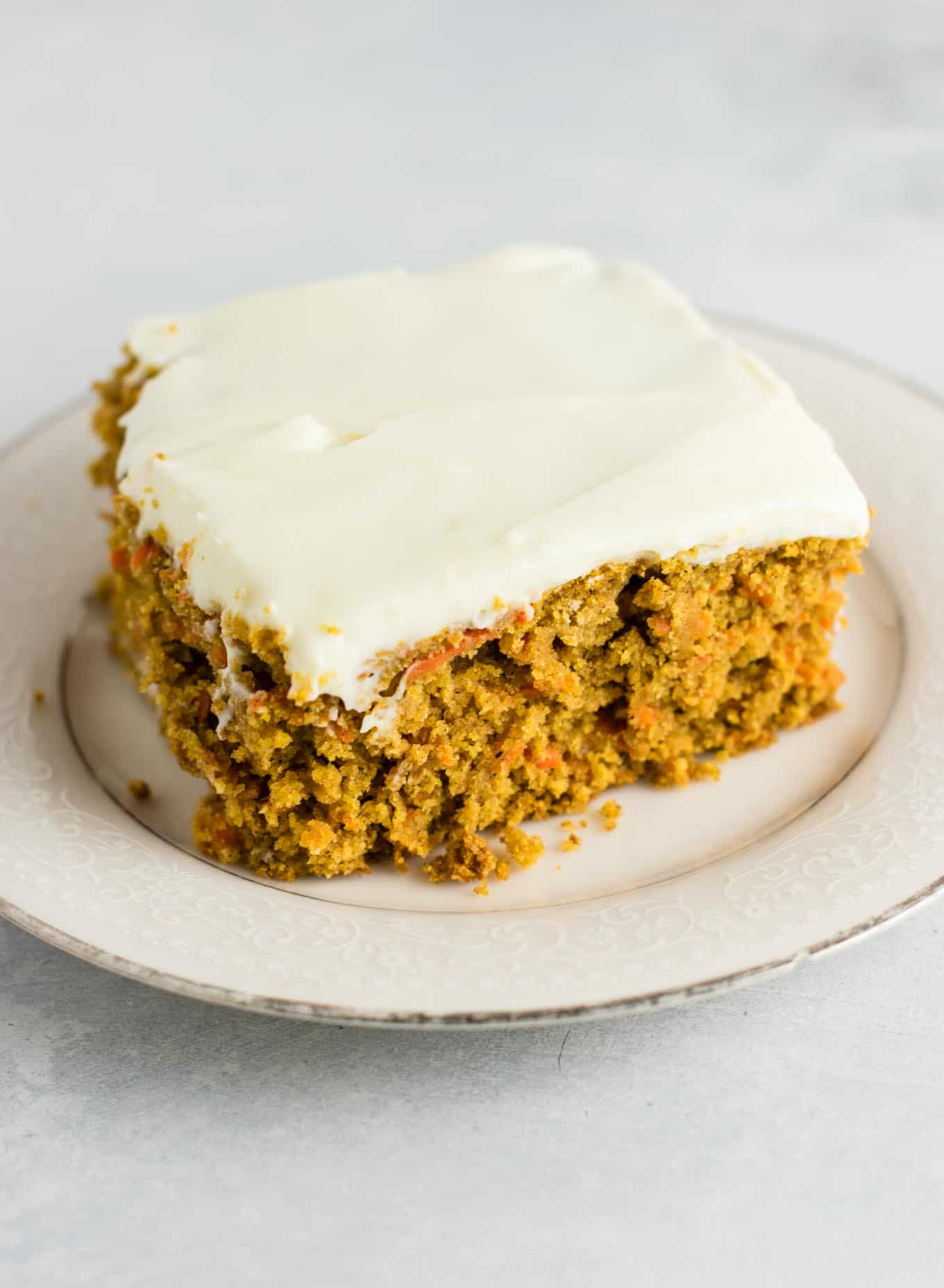 Easy gluten free carrot cake with cream cheese frosting. No hard to find flour blends needed - made with just oat flour and coconut flour. The best gluten free cake I've ever made! #glutenfree #carrotcake #glutenfreecake #creamcheesefrosting #healthydessert #dessert #glutenfreecarrotcake