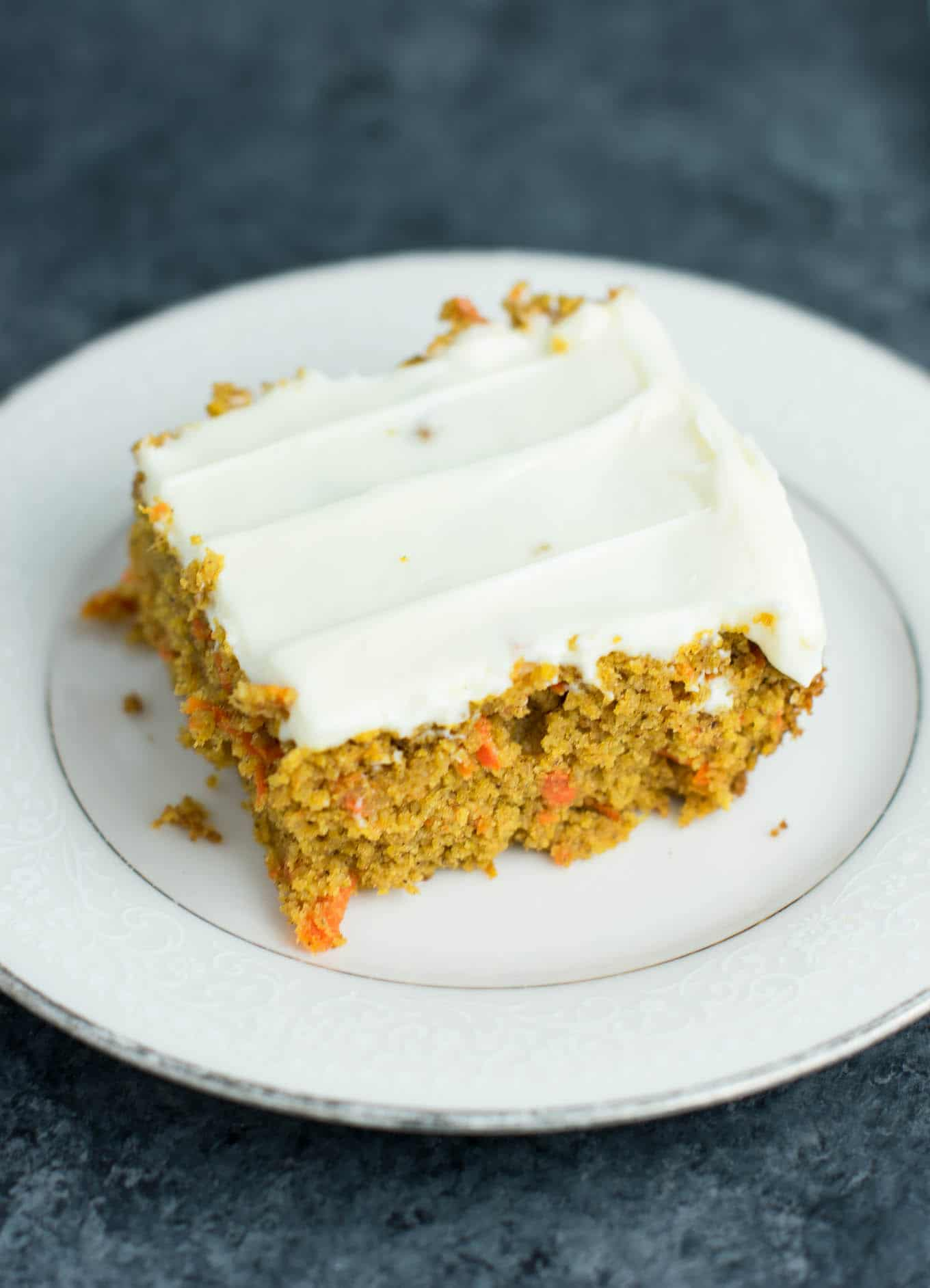The best gluten free carrot cake recipe with cream cheese frosting. Made with two simple flours and no fancy expensive ingredients. No ambiguous all purpose gf flour needed. The easiest and best carrot cake you will ever make! #glutenfree #carrotcake #glutenfreecarrotcake #dessert #healthy