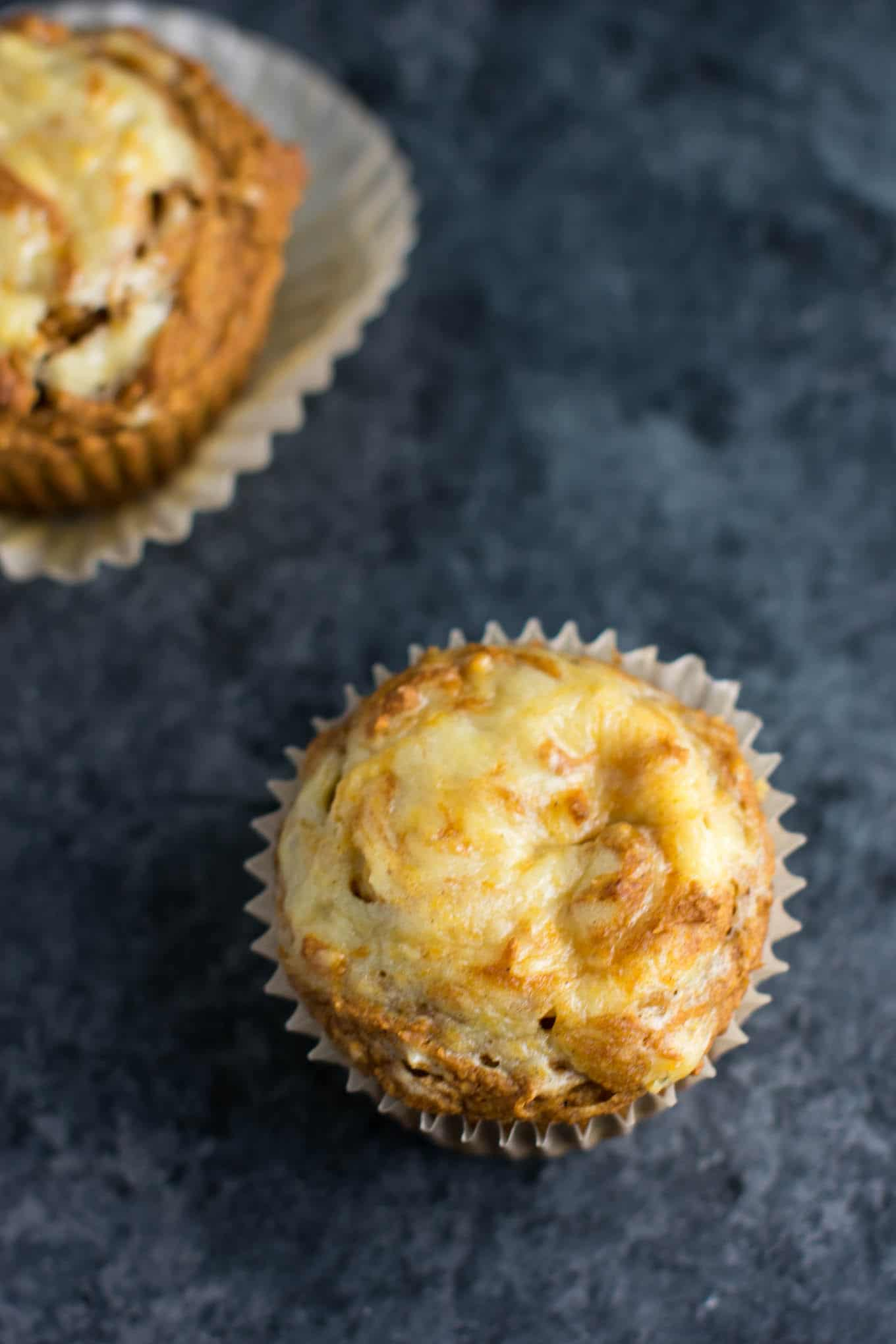 Healthy Pumpkin Cream Cheese Swirl Muffins made with whole wheat pastry flour and without butter or oil. You would never guess that these are healthy! #pumpkincreamcheeseswirl #pumpkinmuffins #healthypumpkinrecipes