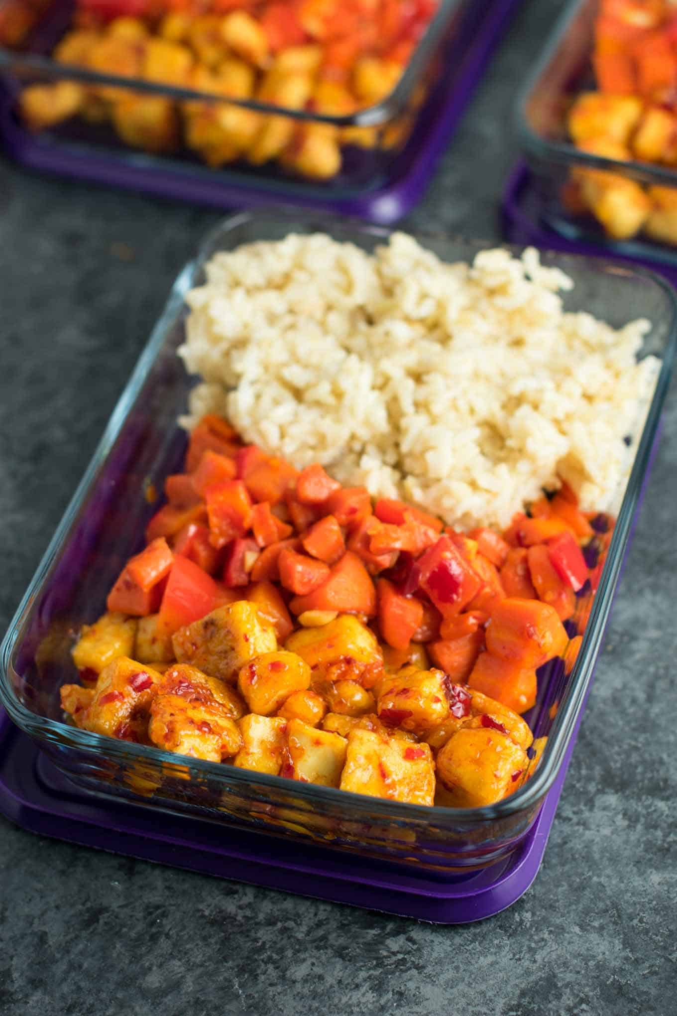 Meal Prep Sweet Chili Tofu Bowls with brown rice and vegetables. A delicious vegan or vegetarian meal! #vegan #vegetarian #veganmealprep #tofu