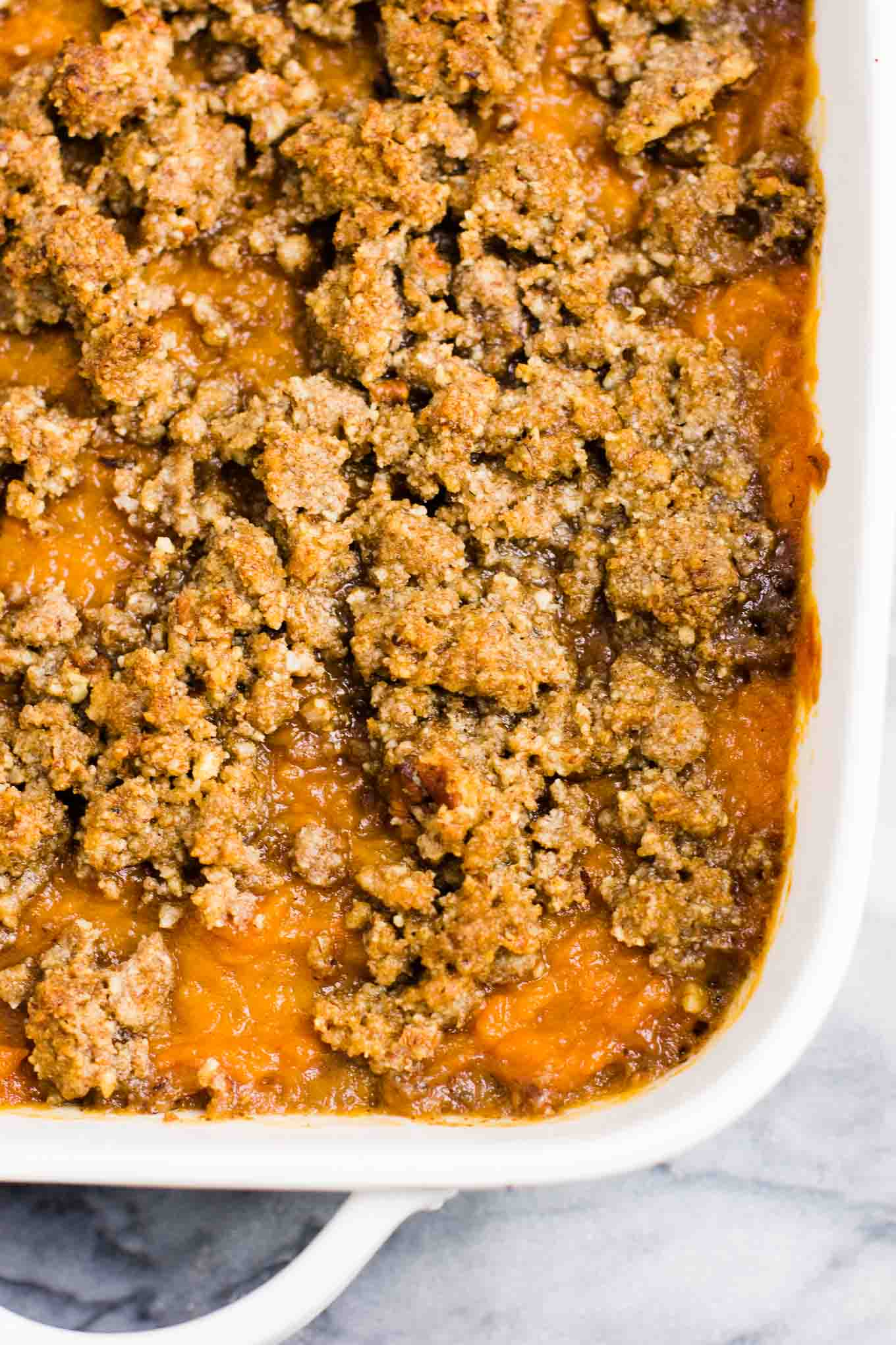 Gluten free sweet potato casserole with pecan crumble. This tastes incredible and everyone loves it! #sweetpotatocasserole #thanksgiving #pecans #glutenfree #vegetarian