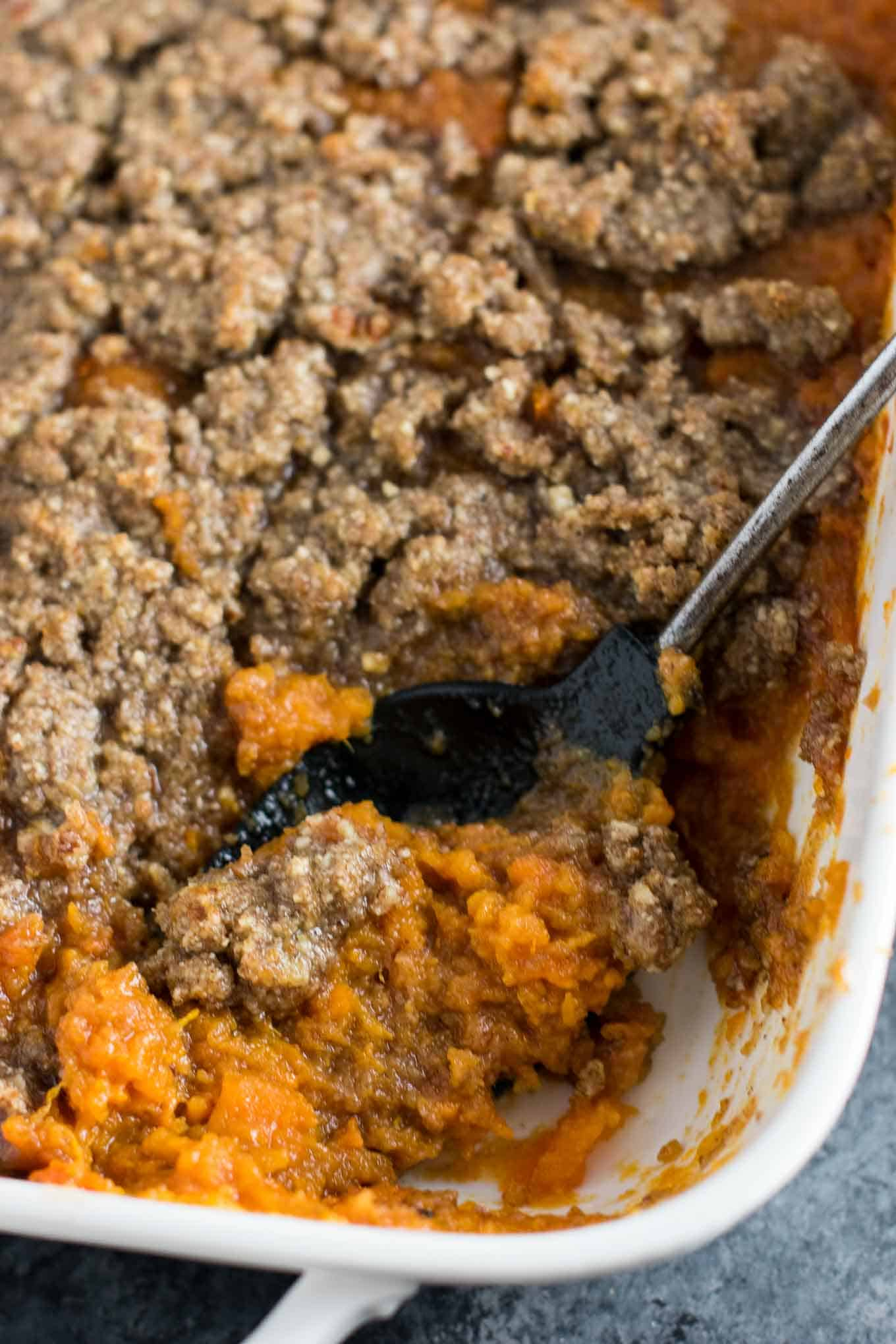 This sweet potato casserole with pecan crumble is the BEST side for your Thanksgiving table! Melt in your mouth buttery sweet potatoes are topped with a salty sweet gluten free pecan crumble. You will be fighting for seconds! #thanksgiving #sweetpotatocasserole #vegetarian #glutenfree