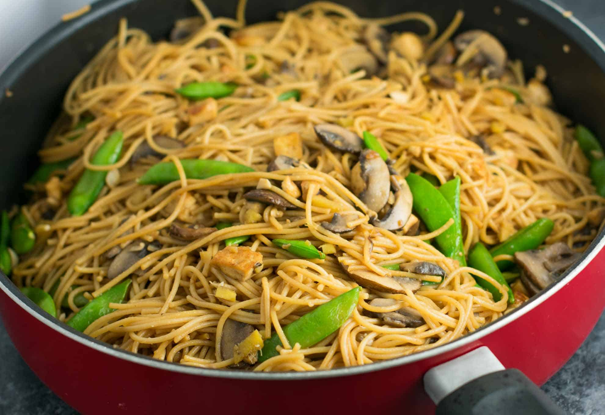 Easy Tofu Lo Mein recipe with fresh vegetables and a simple sauce. Ready in minutes and packed full of protein! #tofu #lomein #vegan #vegetarian