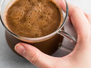Easy 4 Ingredient hot chocolate recipe made with almond milk. Dairy free, gluten free, and vegan. The perfect cozy winter drink! #vegan #hotchocolate #drinks #christmas #dairyfree