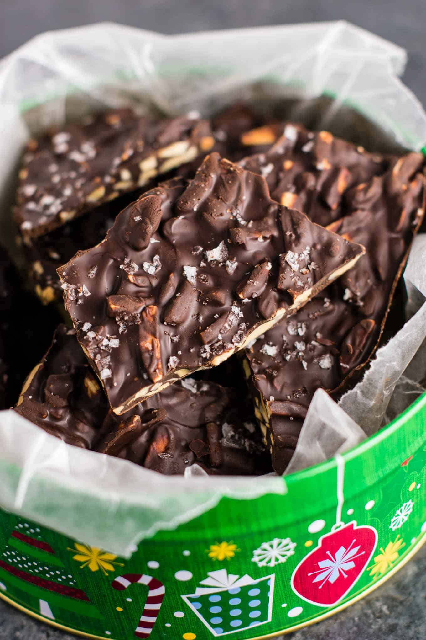 Dark Chocolate Almond bark with sea salt. A seriously addictive + easy to make dessert! (just 5 ingredients!) #vegan #almondbark #desserts #christmas #darkchocolate #healthy