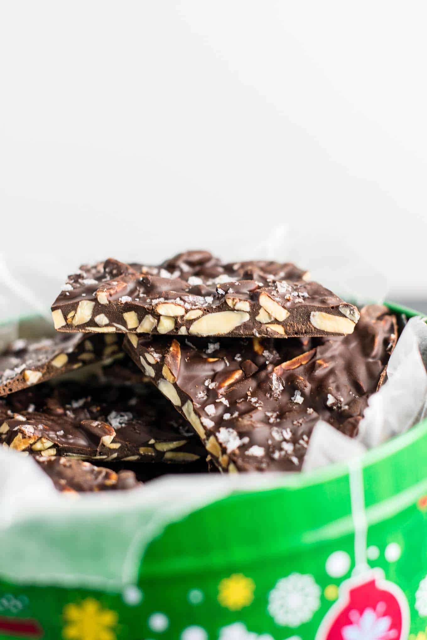 Chocolate Almond bark with sea salt. A seriously addictive + easy to make dessert! (just 5 ingredients!) #vegan #almondbark #desserts #christmas #darkchocolate #healthy