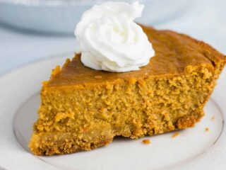 This gluten free pumpkin pie recipe is the only one you'll ever need. Easy to make and melt in your mouth delicious! #ad #MIDELicious #glutenfree #pumpkinpie #dessert