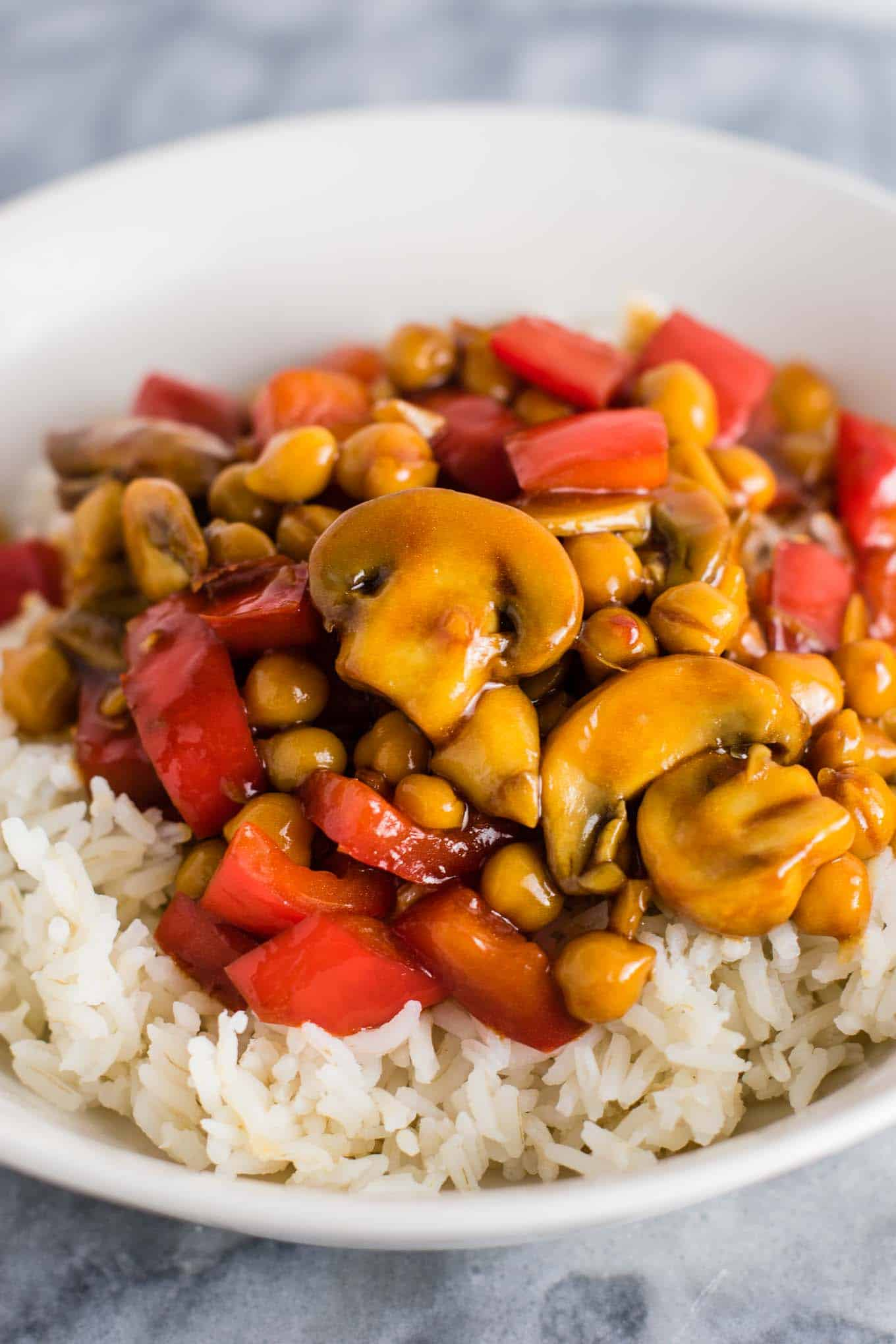 30 minute chickpea stir fry recipe with bell peppers, mushrooms, and homemade stir fry sauce. My go to easy vegan dinner! #chickpeastirfry #vegan #dinner #30minutedinner #vegandinner
