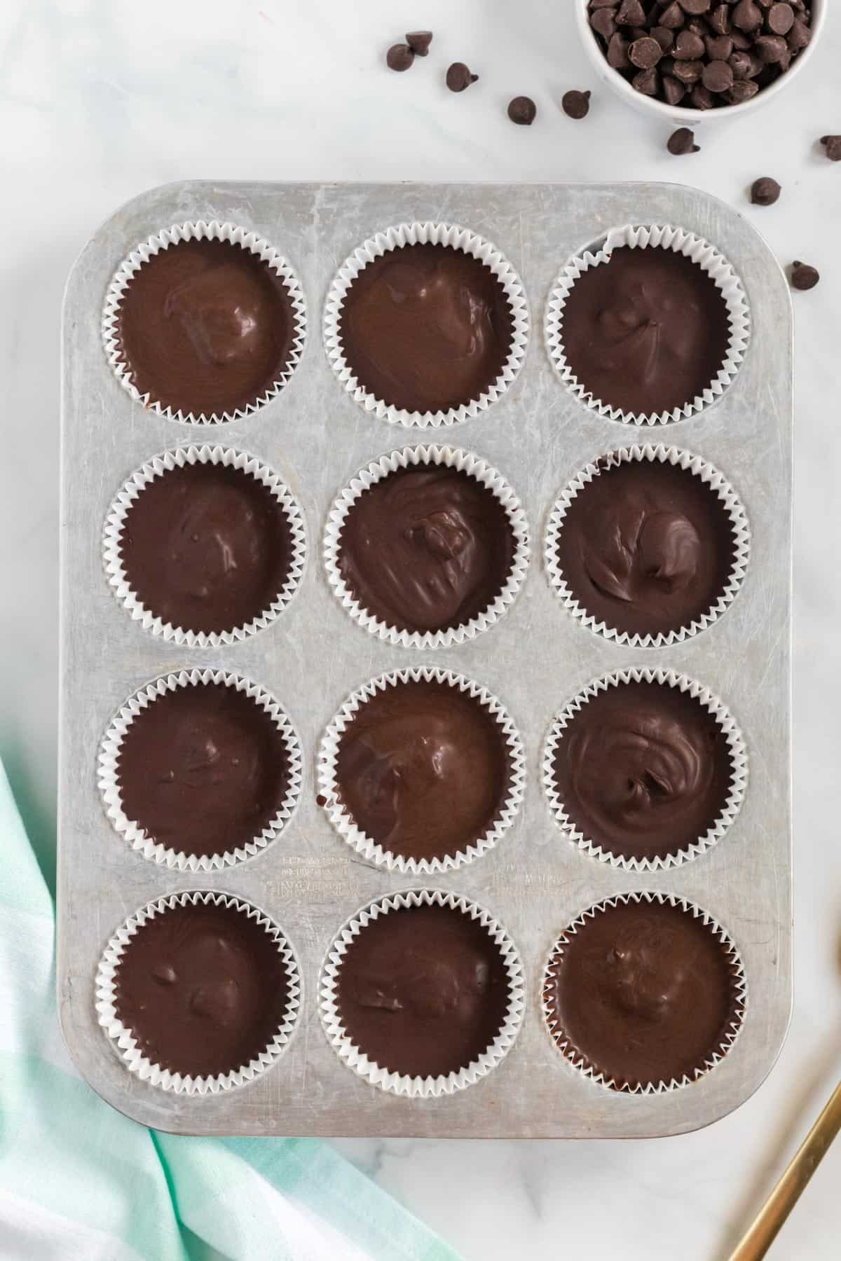 vegan peanut butter cups chilled in the muffin tin
