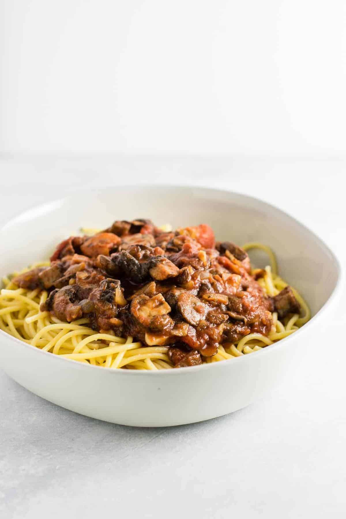 meatless spaghetti sauce over pasta in a white bowl
