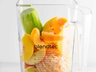 Ginger peach detox smoothie recipe with fresh cucumber and lemon. Packed full of healthy ingredients, naturally vegan, and so refreshing! #healthysmoothie #detoxsmoothie #gingerpeachsmoothie #vegan #smoothierecipes