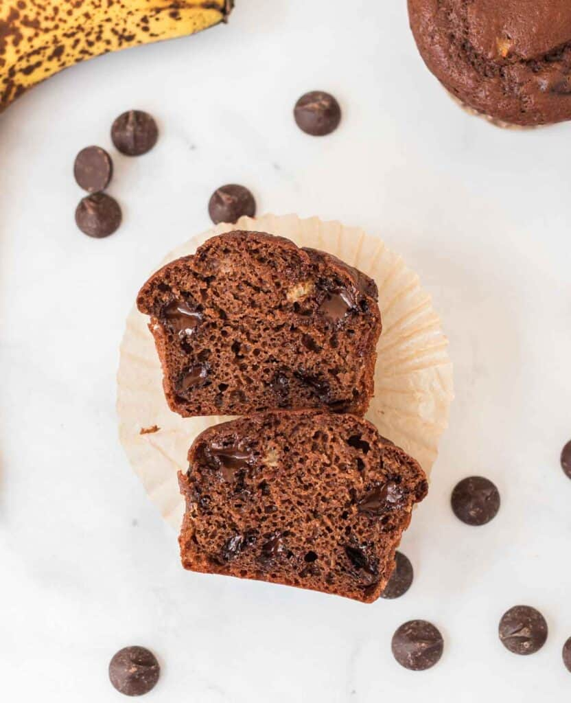 chocolate muffin cut in half to show the inside