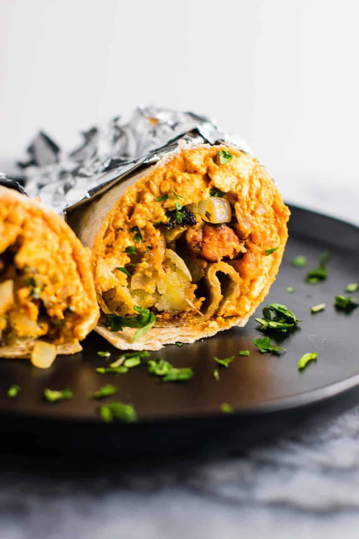 The BEST vegan breakfast burrito recipe you'll ever try! Made with scrambled tofu and crispy vegan breakfast hash. #veganbreakfastburrito #veganbreakfast #vegan #breakfastburrito