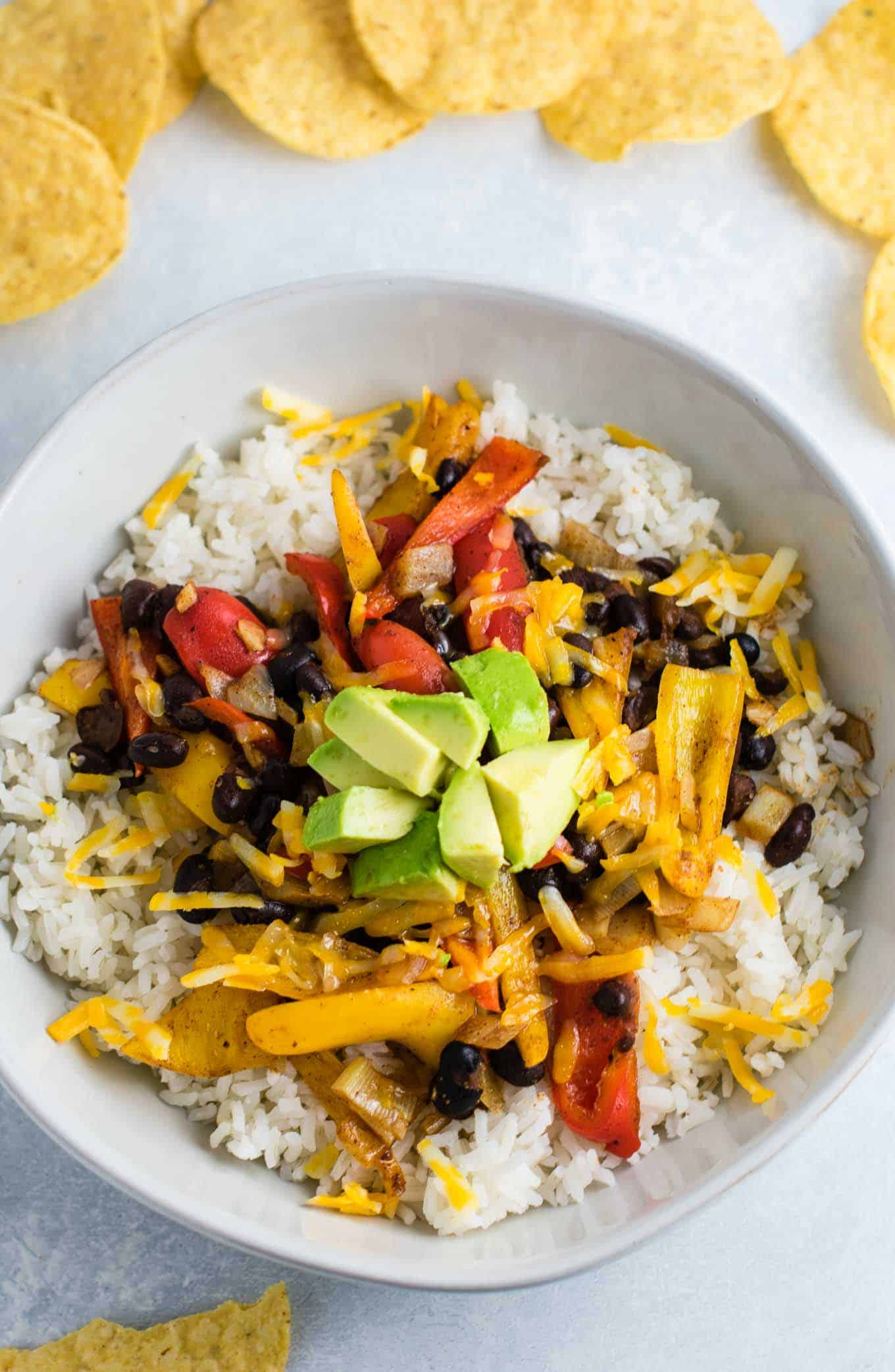 Vegetarian burrito bowl recipe with black beans, mini bell peppers, garlic, and onion. Better than chipotle! An easy vegetarian meal prep recipe or dinner the whole family will love! #vegetarianmealprep #vegetarianburritobowl #dinner #healthy #vegetarian