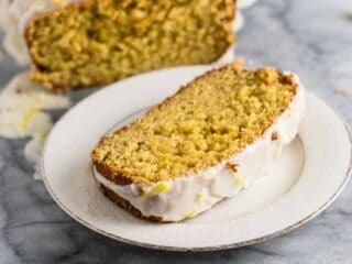Mind blowing healthier greek yogurt lemon loaf! Made with healthier ingredients and melt in your mouth delicious #greekyogurtlemonloaf #lemonloaf #coconutoil #healthy #lemonbread