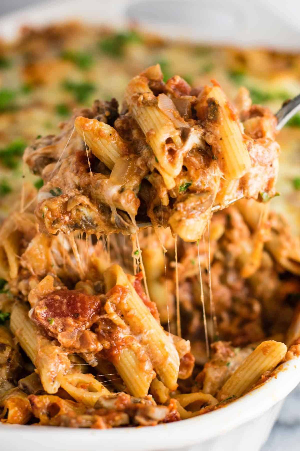This Meatless Million Dollar Baked Ziti Recipe is an easy and impressive vegetarian dinner. Full of meaty mushrooms, fresh herbs, and four types of cheese! #meatless #milliondollarziti #bakedziti #vegetarian #dinner