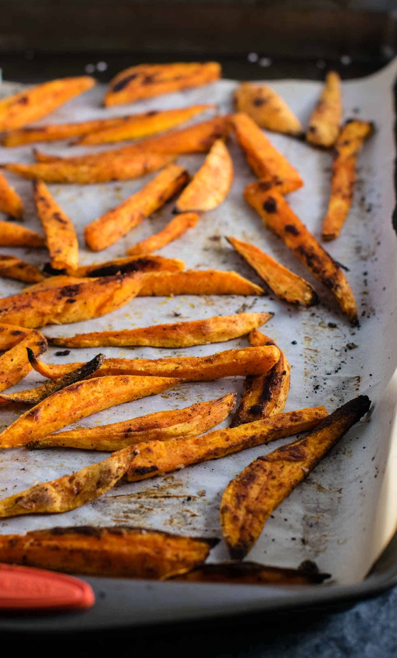 I am obsessed with these roasted sweet potato fries! The perfect combo of salty sweet and the spices are perfect. So easy and go with everything! #sweetpotatofries #vegetables #sidedish #vegan #dinner #roastedsweetpotatofries