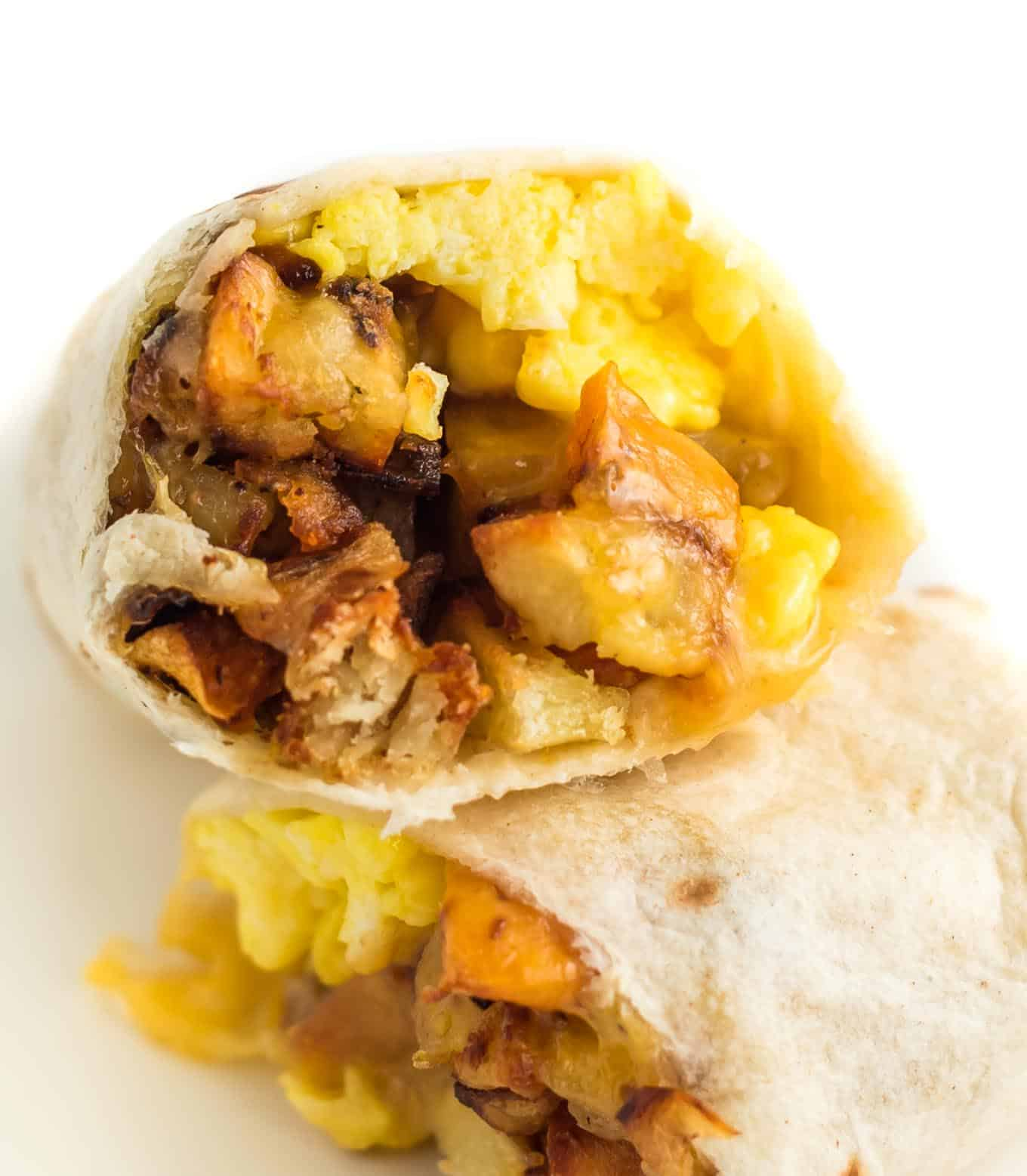 breakfast burrito stuffed with scrambled eggs and hash