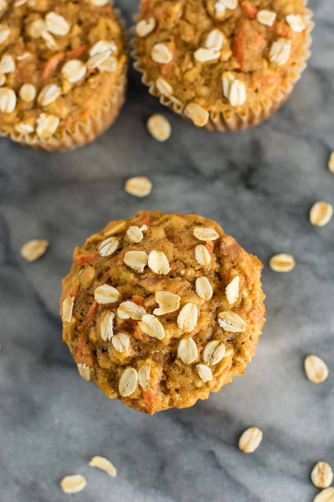 Wholesome Carrot Apple Muffins made with pure maple syrup and greek yogurt. Kids will love these! A feel good breakfast or snack for the whole family. (oil free, naturally sweetened) #carrotapplemuffins #healthymuffins #healthysnack #kidfriendlysnack #greekyogurt #vegetarian