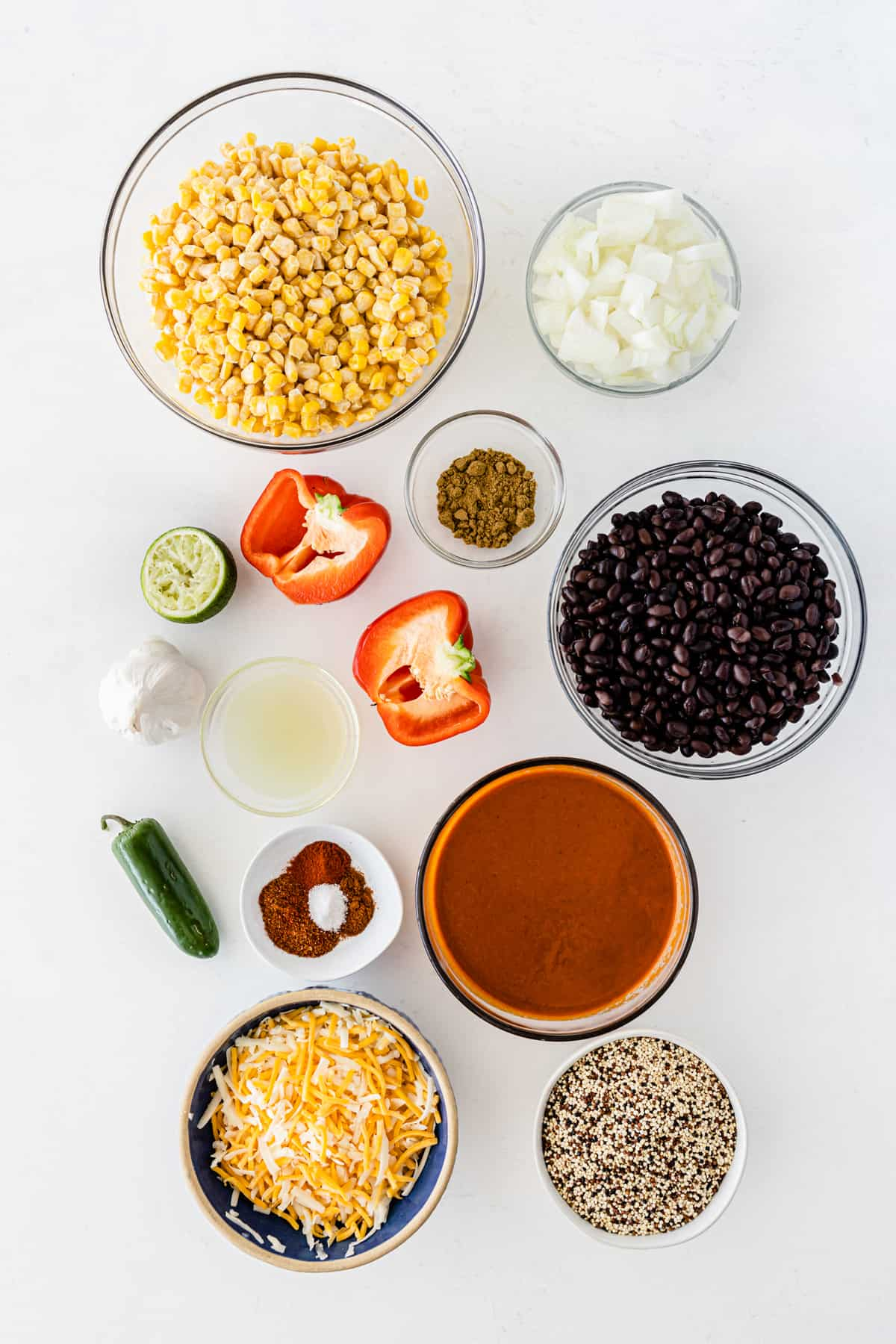 the ingredients for the quinoa casserole lined up on a white board