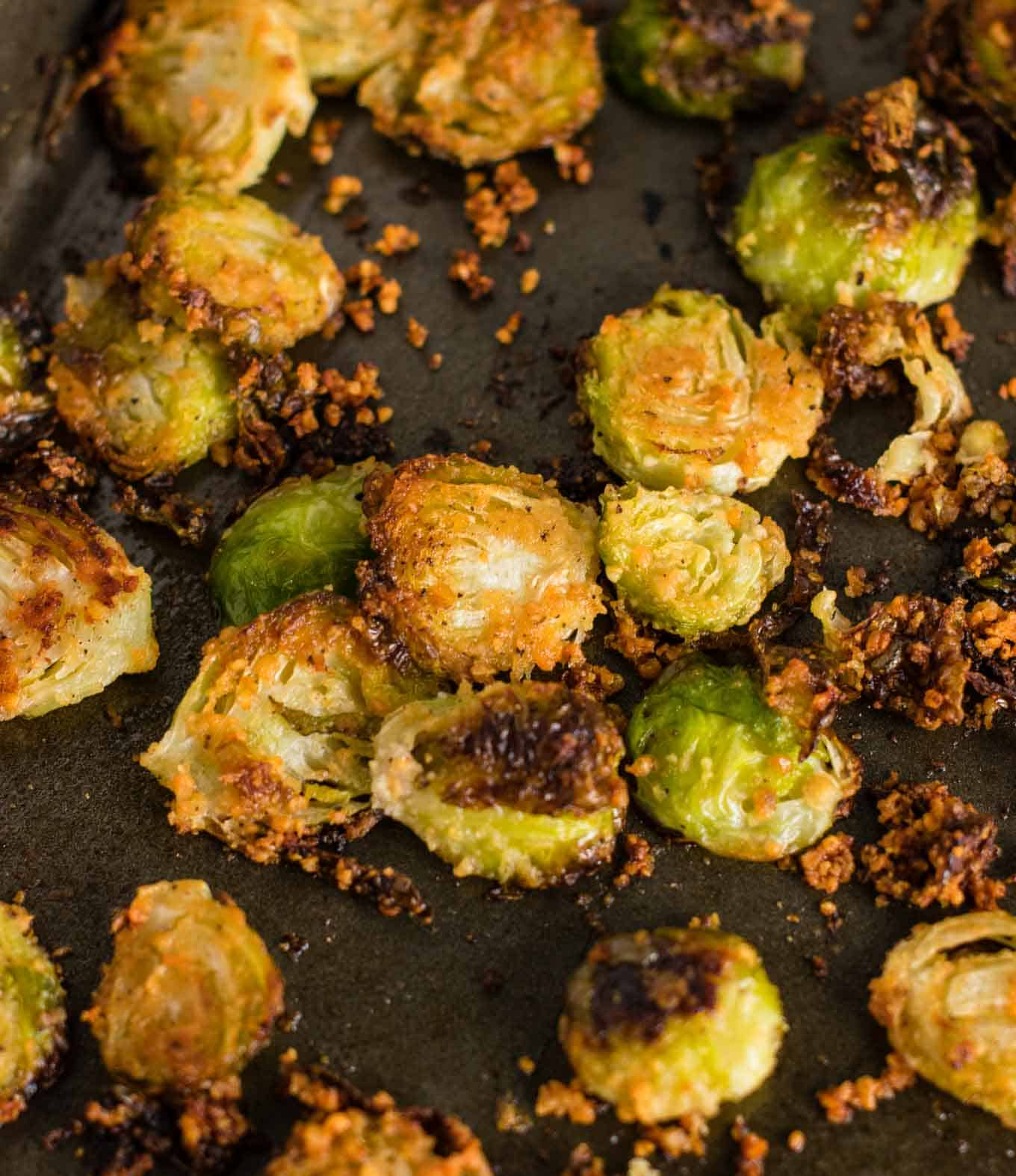 roasted brussel sprouts chips - these are so good I could eat the whole pan myself! #brusselsprouts #brusselsproutchips #dinner #sidedish #vegetarian