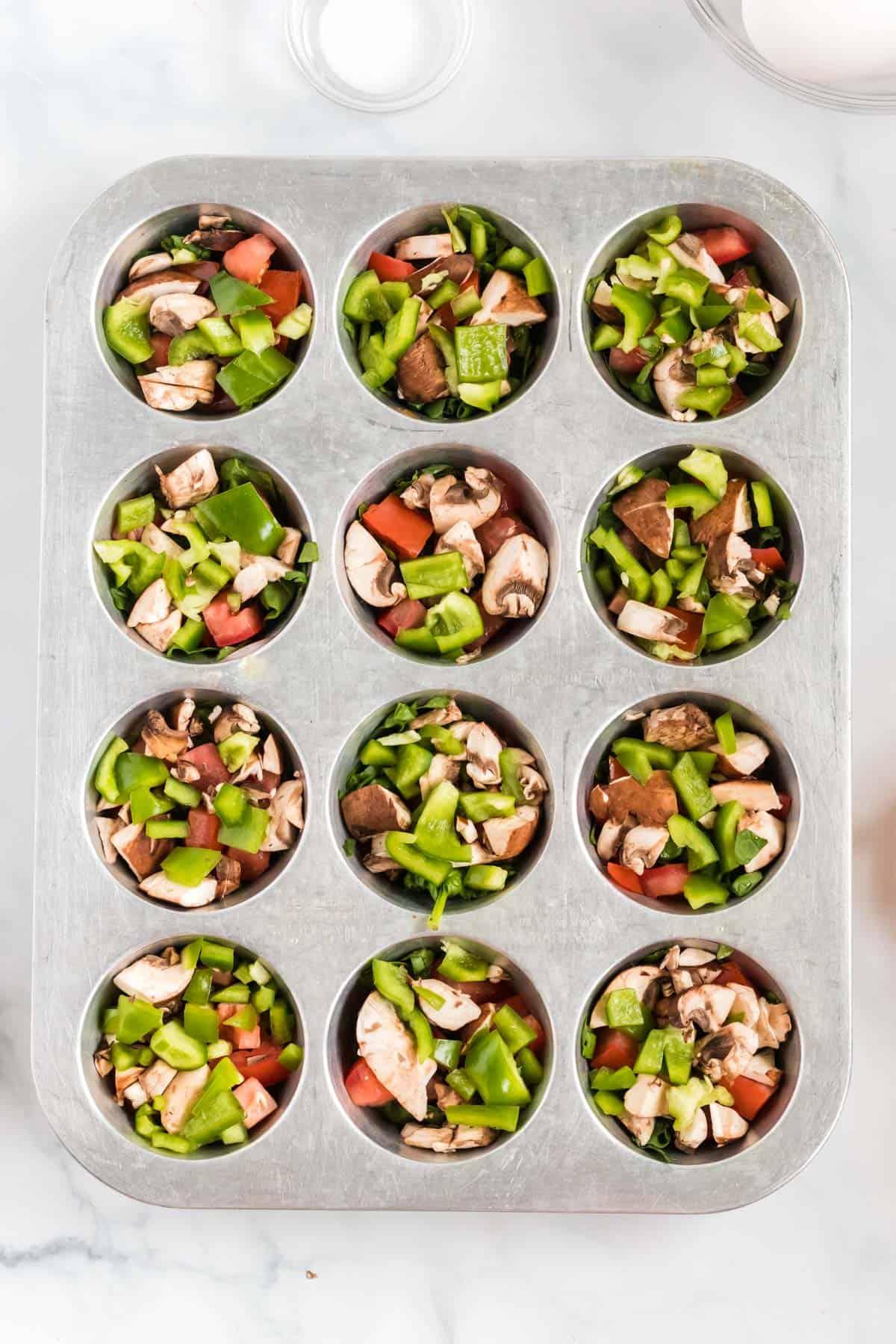 cut up veggies inside a muffin tin