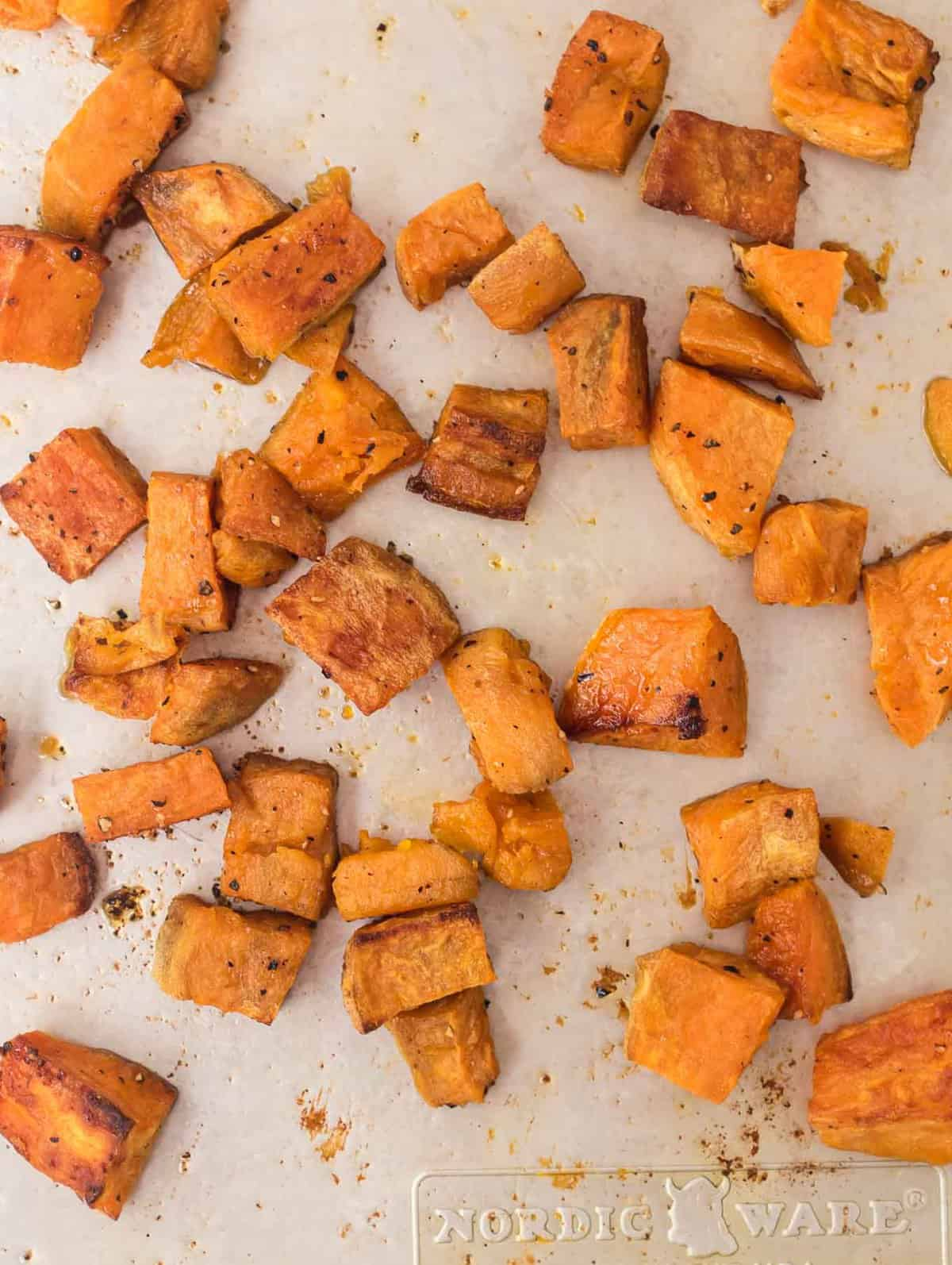 roasted sweet potatoes cubed on a baking sheet
