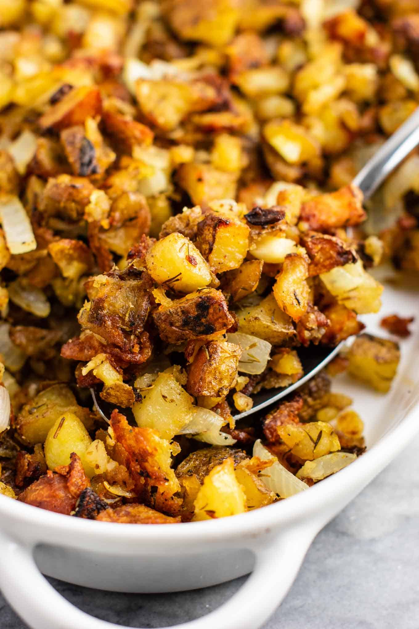 This famous crispy potato casserole is SO GOOD! Perfectly crispy potatoes slow roasted to perfection. One of the best vegan potato recipes! #potatocasserole #vegan #veganpotatorecipes #dinner #potatoes #healthy