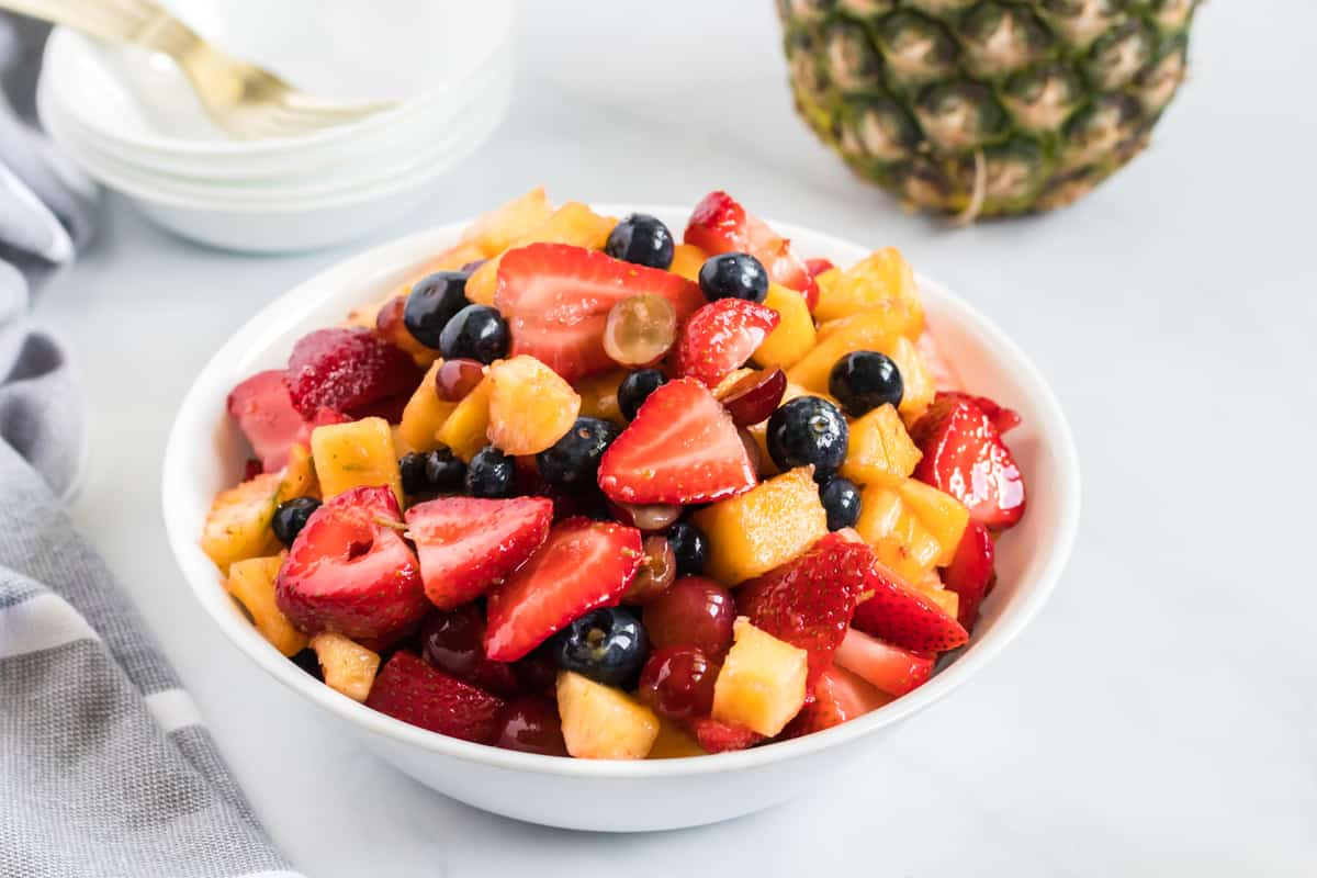 fruit salad in a small white serving bowl