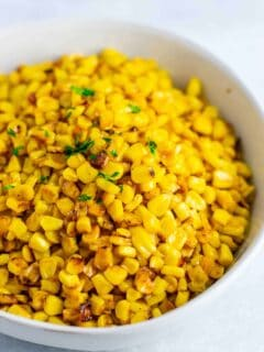 Best skillet corn recipe –the BEST side dish and even corn haters will love it. you will never make corn a different way after you try this! #skilletcorn #sidedish #dinner #dinnerrecipe #glutenfree #corn #easysidedish