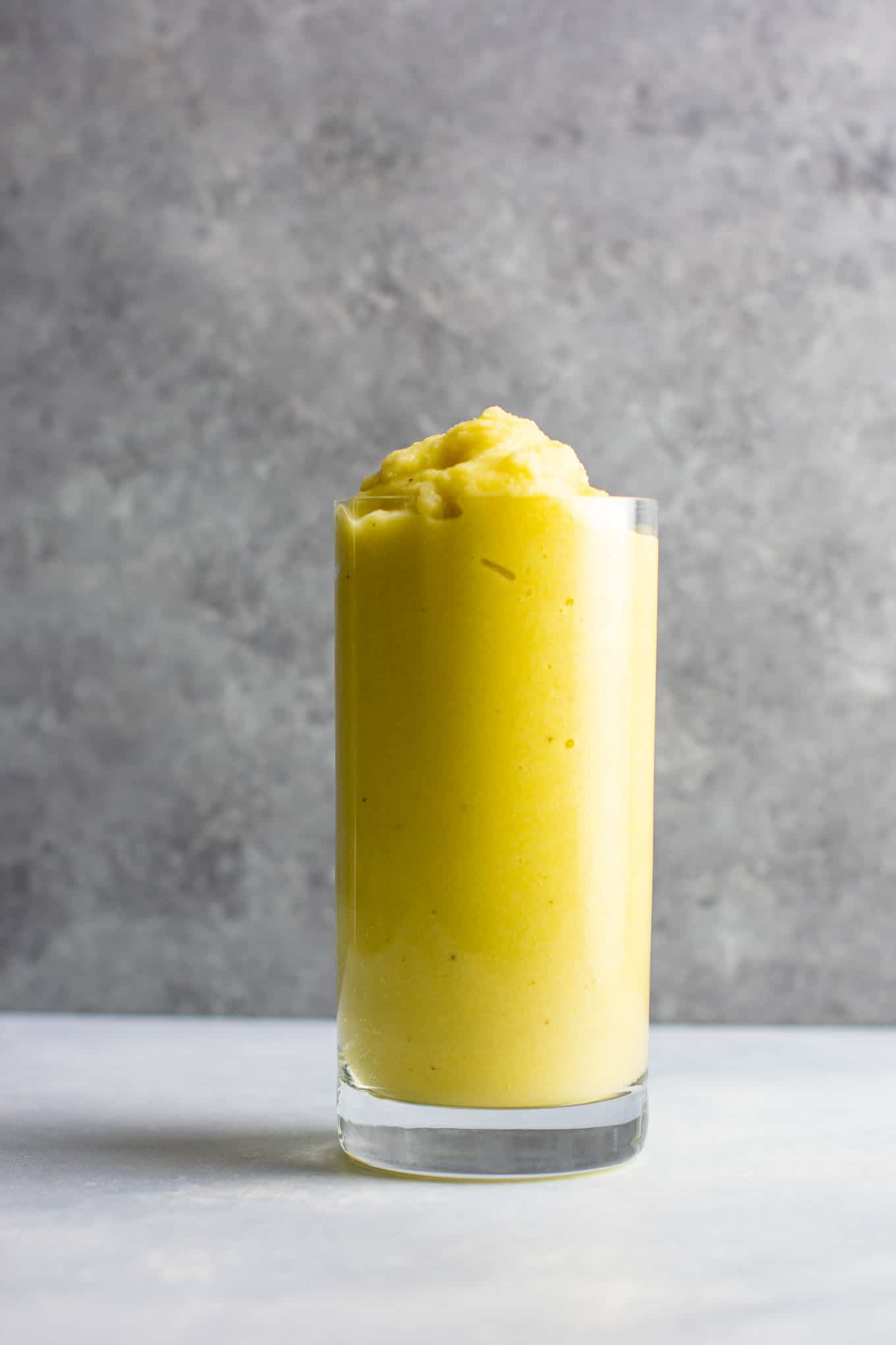 Pineapple detox smoothie with cucumbers, celery, lemon, peaches, ginger, and frozen bananas. A healthy smoothie recipe that tastes delicious! #detox #detoxsmoothie #healthysmoothie #vegan #healthyeating #healthyrecipe #smoothie #vegansmoothie