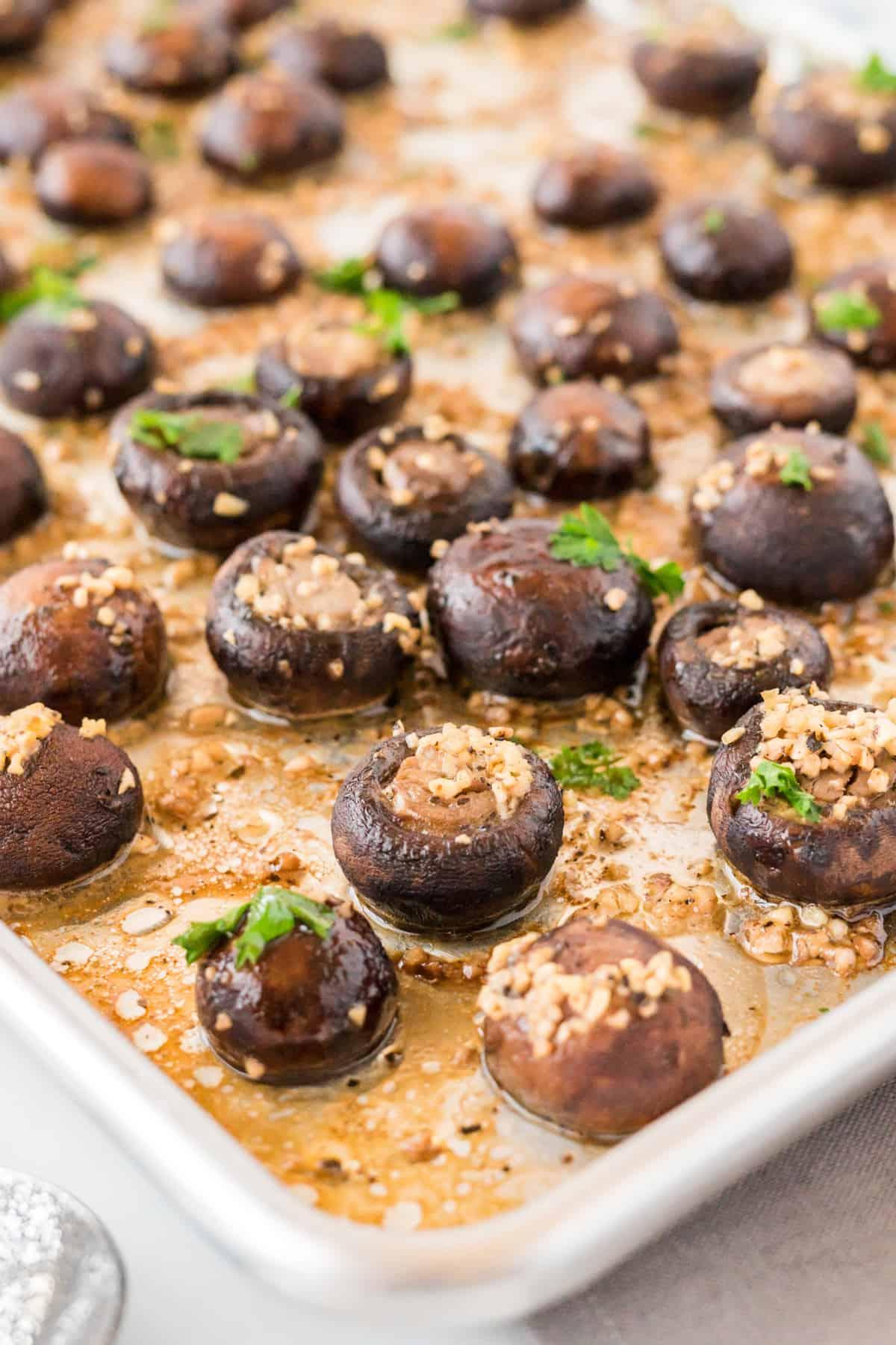 mushrooms roasted in garlic butter on a baking sheet