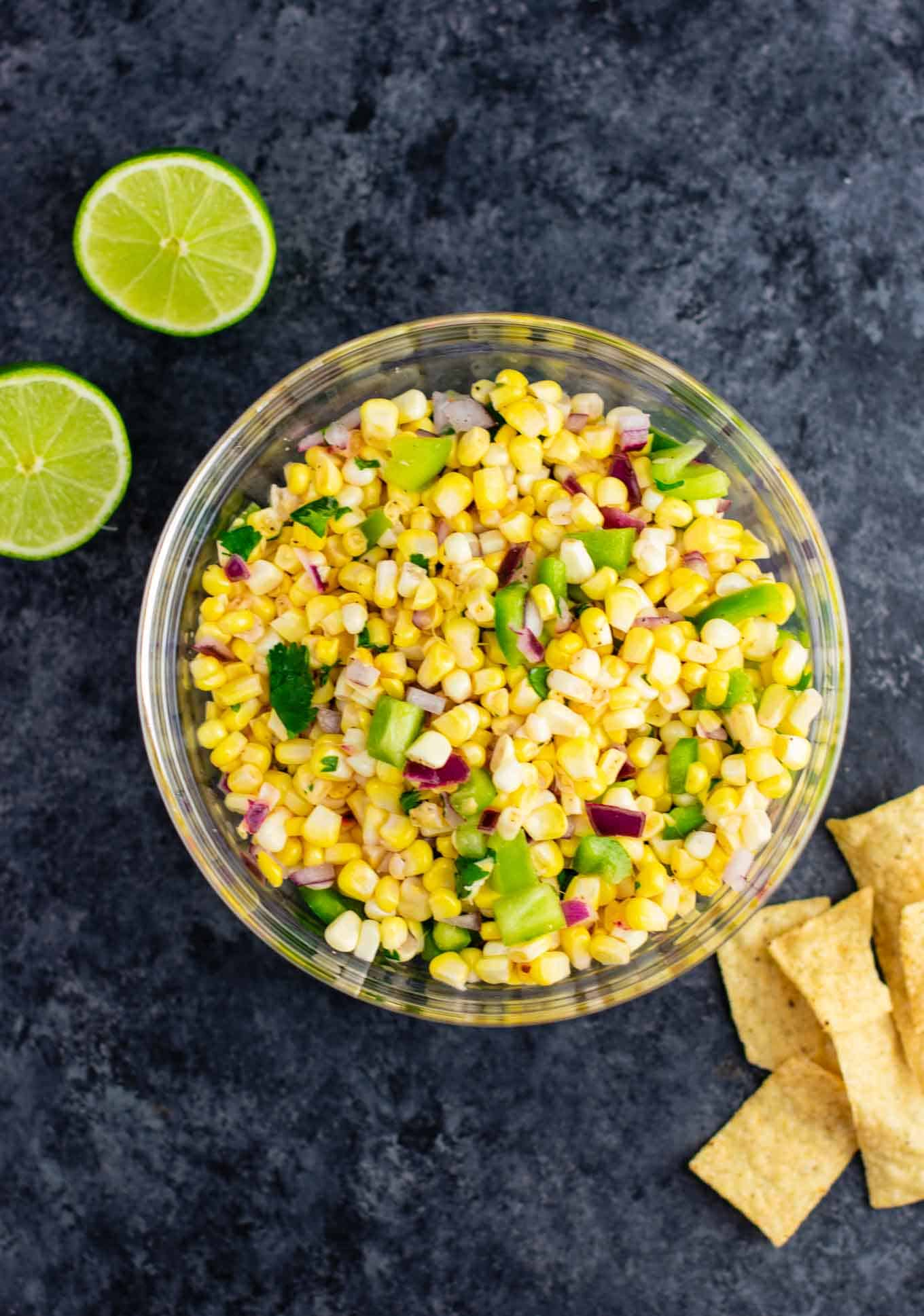 vegetarian mexican recipes:The best easy fresh corn salsa recipe made with just a few ingredients. It tastes better than chipotle and is ready in minutes! Make your own burrito bowls at home with this awesome corn salsa. #chipotlecornsalsa #cornsalsa #chipotle #burritobowl #appetizer #vegan #corn #appetizer